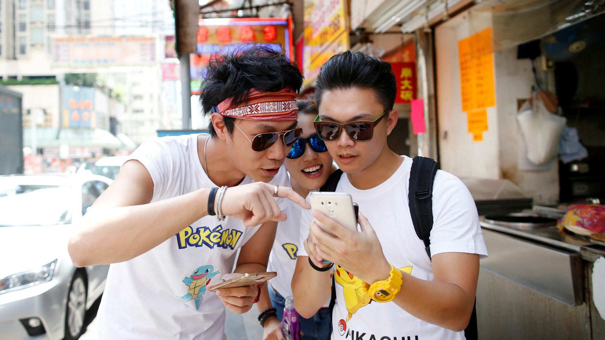 Men playing Pokemon Go