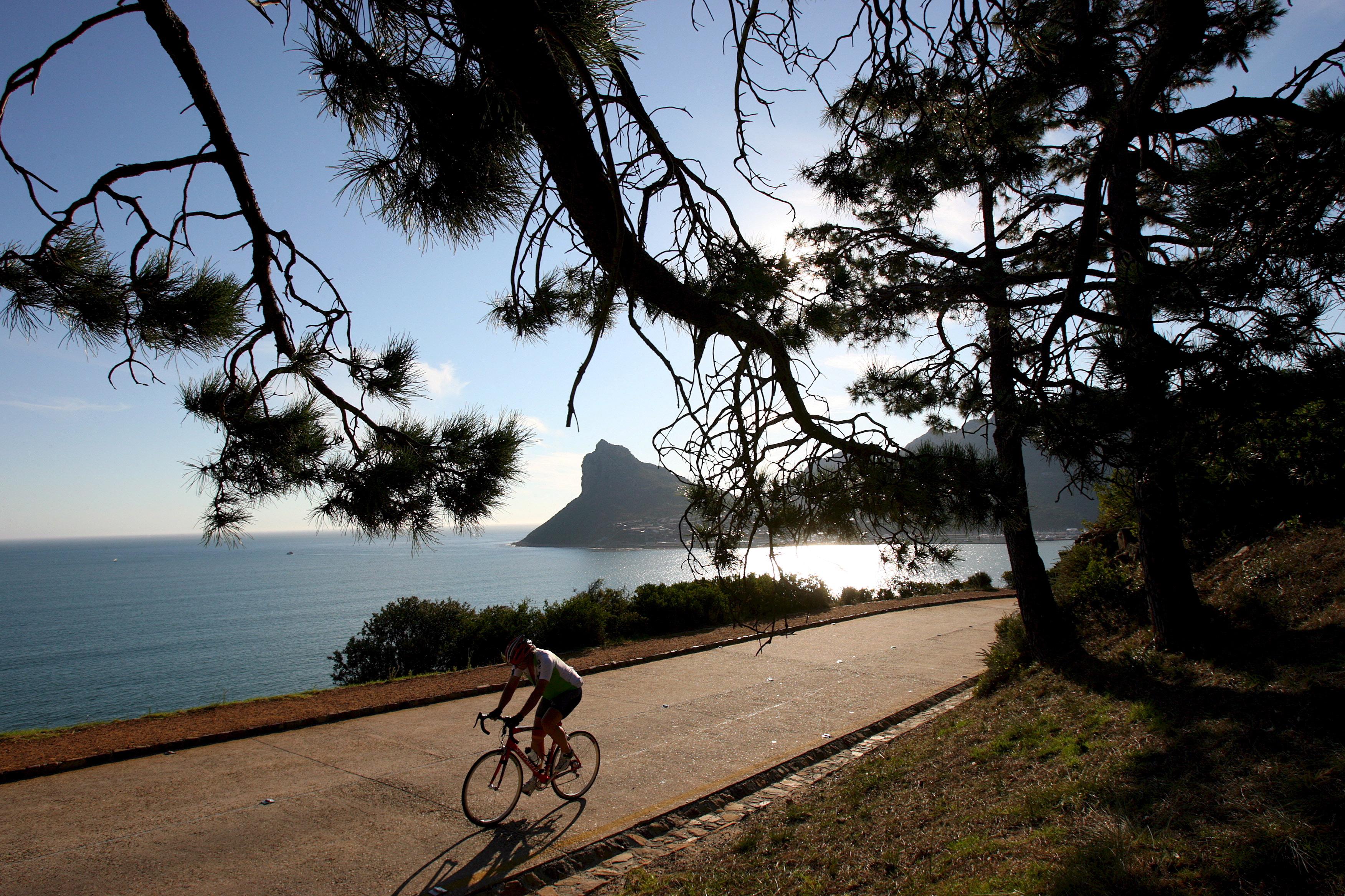 Biker bikes on bike path.