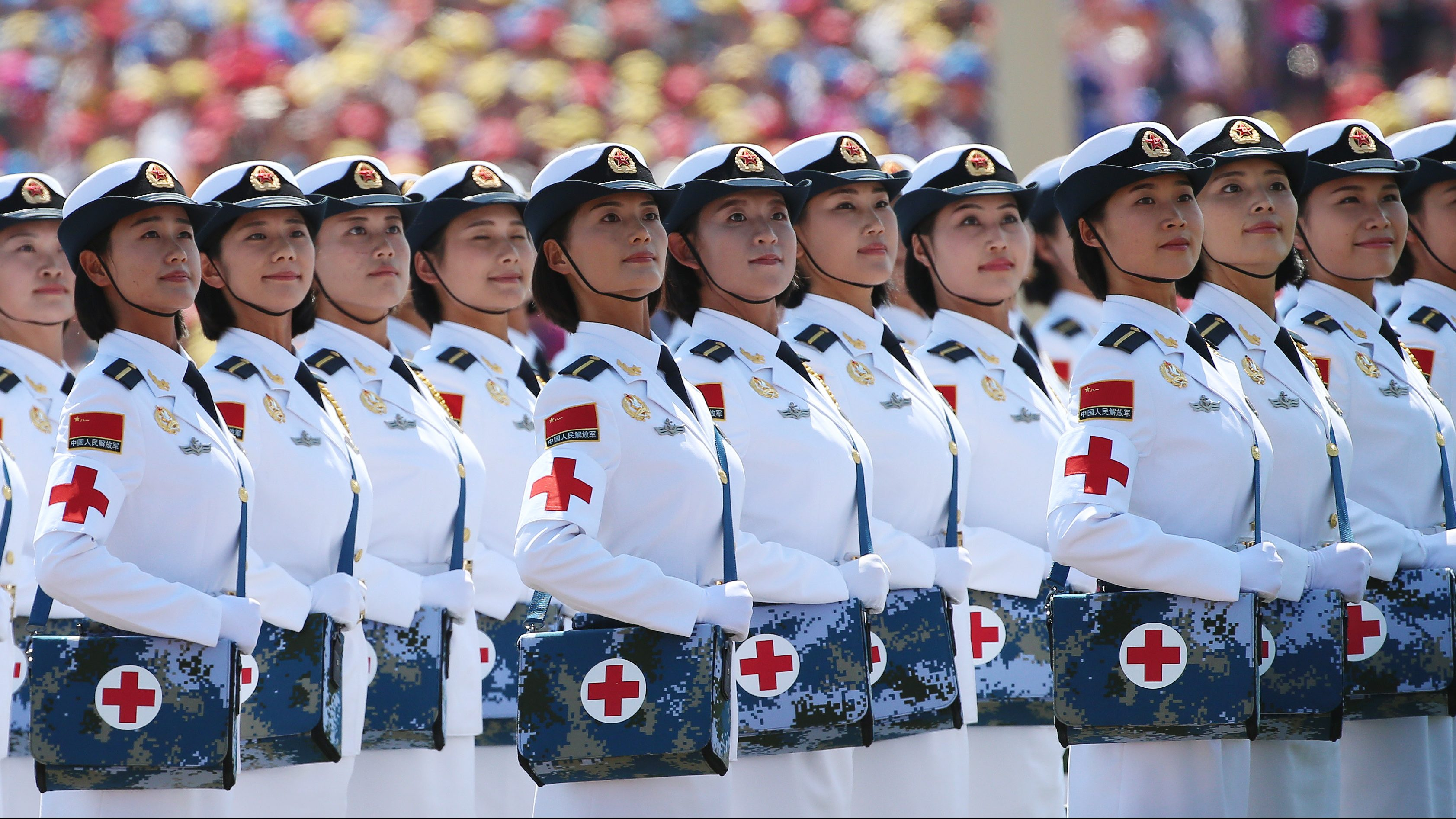 Chinese female medical corps soldiers march on Tiananmen Square during a military parade marking the 70th Anniversary of the Victory of Chinese People's Resistance against Japanese Aggression and World Anti-Fascist War at Tiananmen Square in Beijing, China, 03 September 2015. China holds a military parade as one of the events taking place around the World marking the 70th Anniversary of the WWII Victory over Japan Day which marks the day Japan officially accepted the terms of surrender imposed by the by Allied Forces in the Pacific conflict.