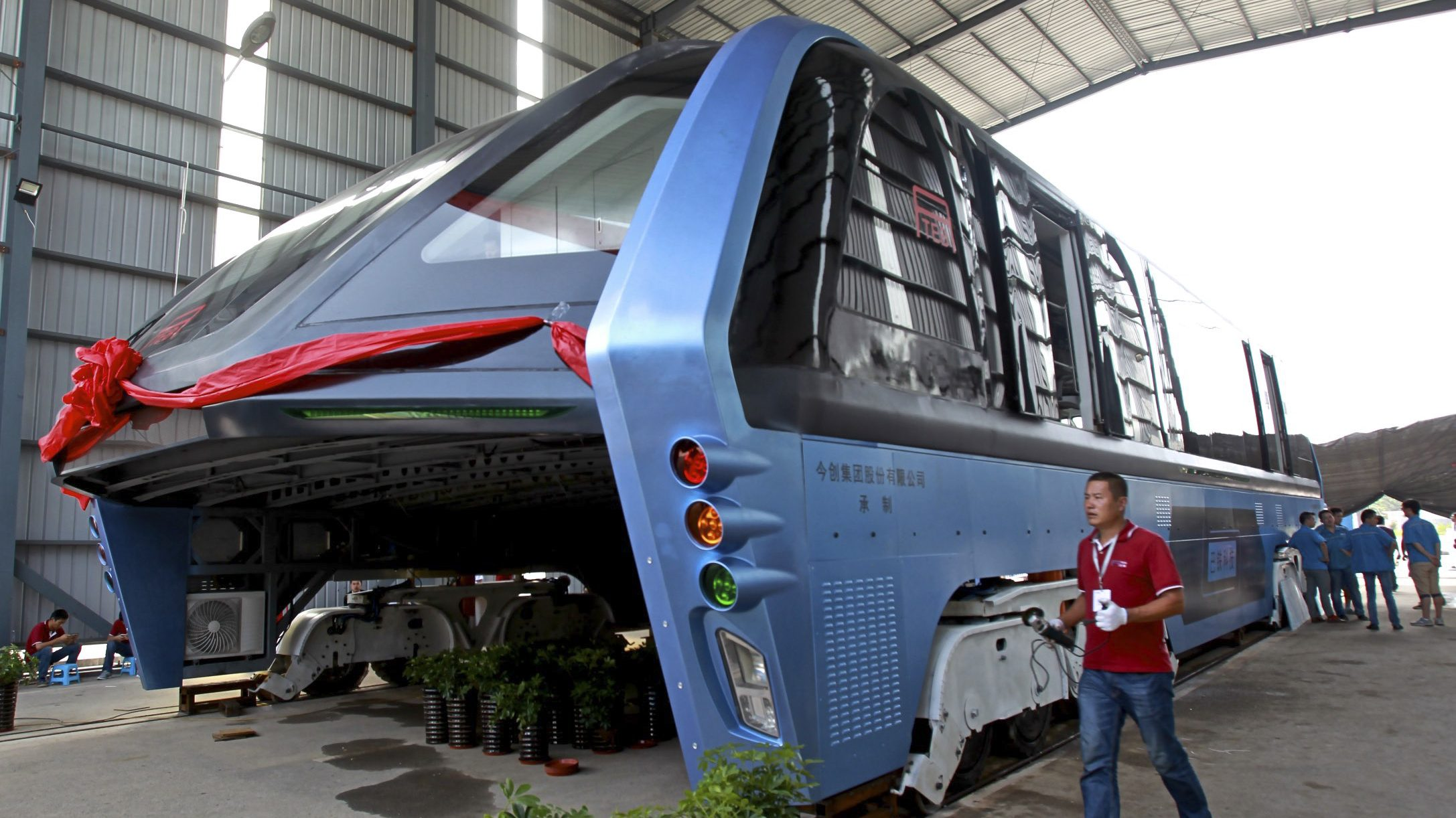 A picture made available 05 August 2016 shows a Transit Elevated Bus (TEB) parked in a garage in Qinhuangdao City, Hebei Province, China, 03 August 2016. The TEB, which is estimated at 2 meters high, 21 meters long and 7 meters wide, was first introduced through a mini-model at the 19th China Beijing International High-Tech Expo in May. It is estimated to be able to carry 300 passengers.