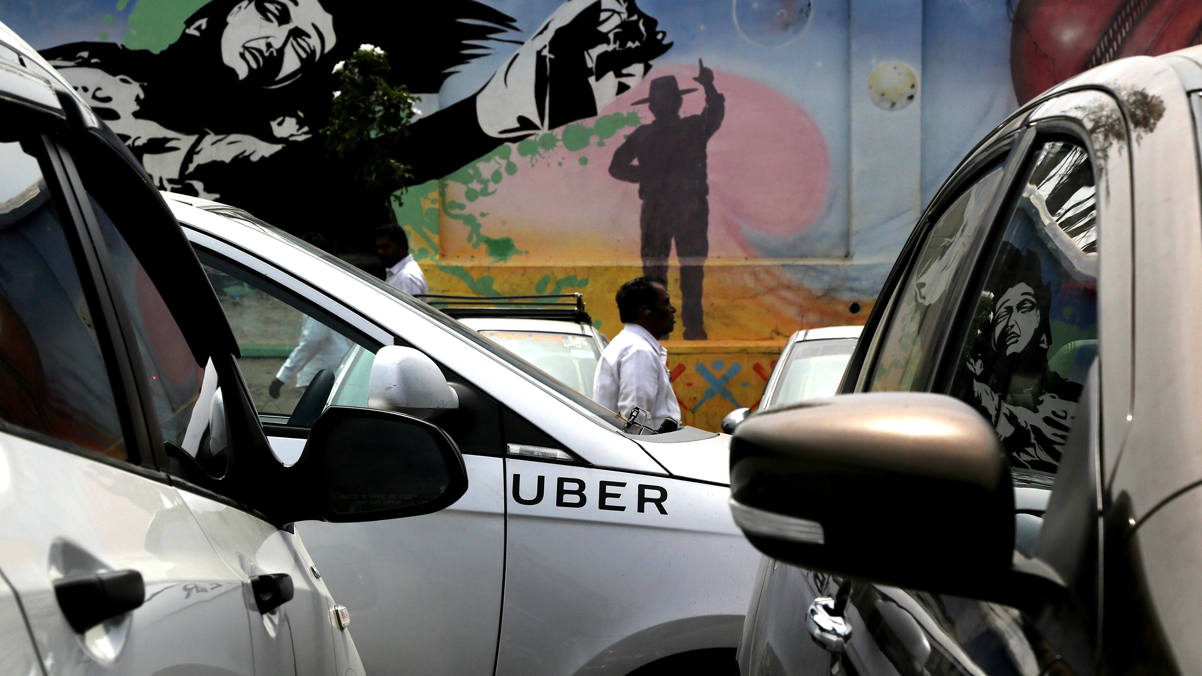 epa05822288 Ola and Uber cabs are parked during a strike against the mobile app based taxi booking services Ola Cabs and Uber in Bangalore, India, 01 March 2017. Hundreds of Ola and Uber cab drivers started an indefinite strike in Bangalore on 22 February demanding better incentives.  EPA/JAGADEESH NV
