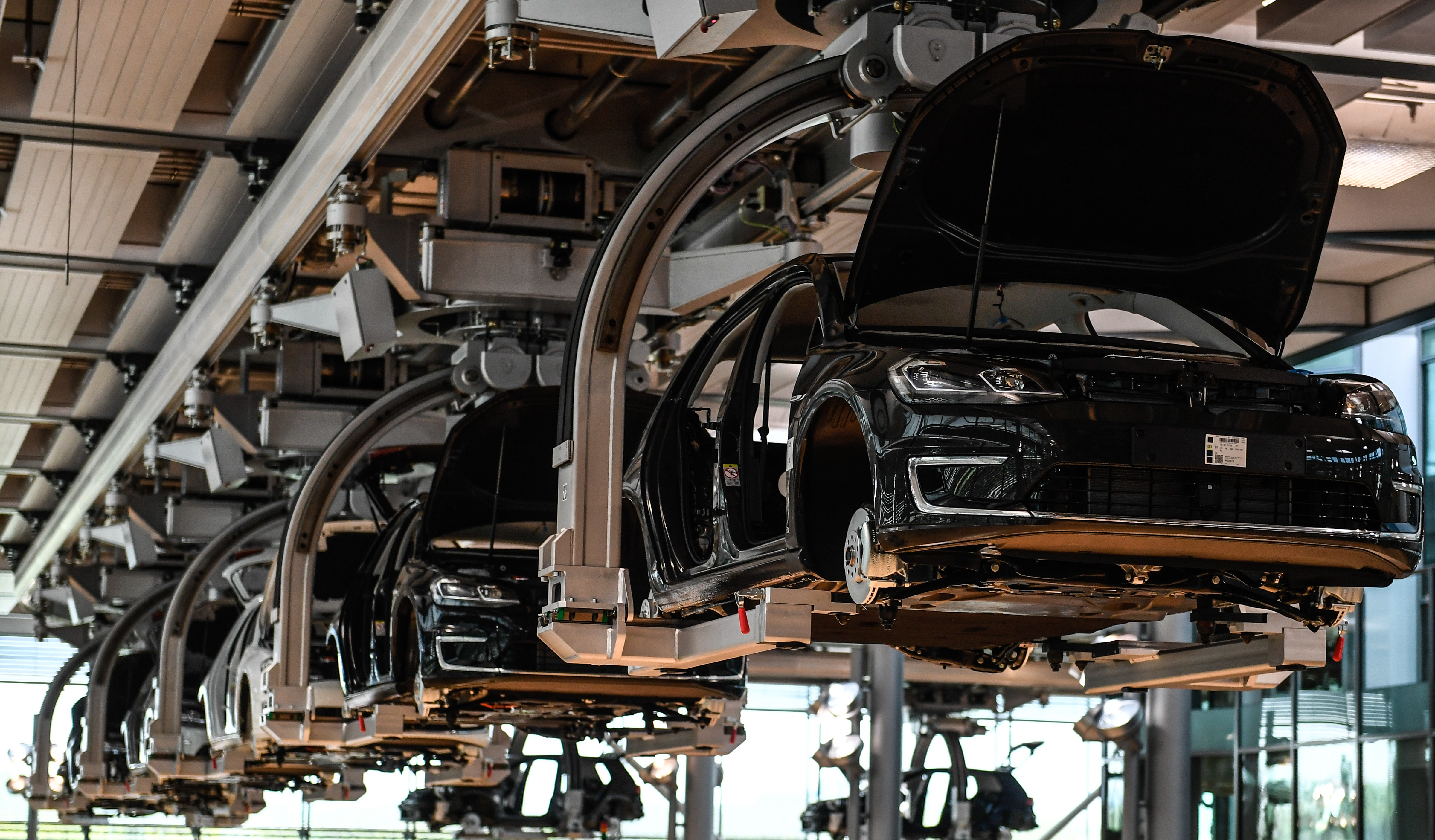 A view of the e-Golf production line at the so-called 'Glaeserne Manufaktur' ('Transparent Factory') in Dresden, Germany, 25 April 2017. In April 2017 the German car automaker VW started a new production line of battery-powered electric cars. According to the company, the Dresden Transparent Factory produces about 25 Volkswagen e-Golf per day