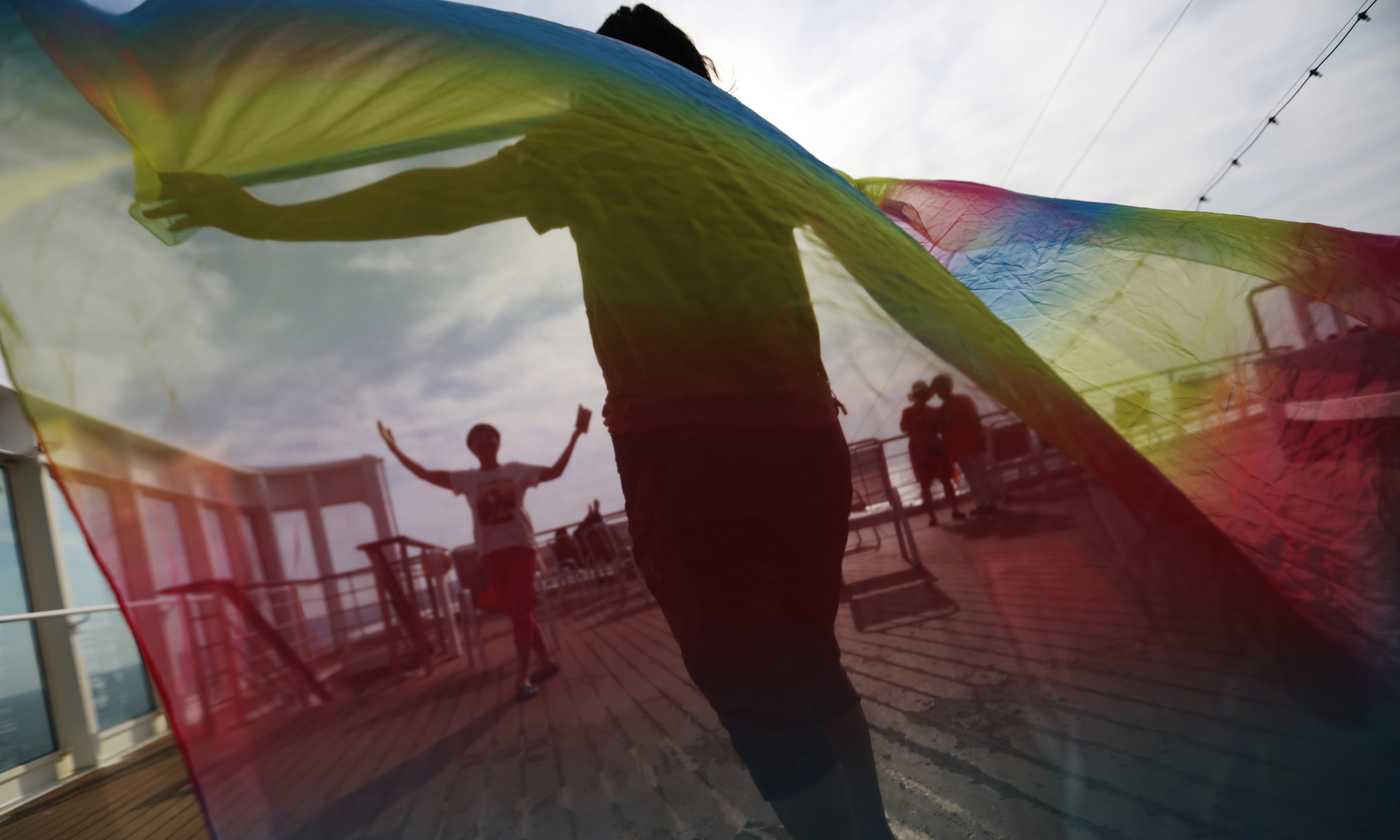 epa06037446 (03/34) Members of the Parents and Friends of Lesbians and Gays (PFLAG) China organisation pose for photos with a rainbow coloured scarf on the deck of a cruise where the 10th National PFLAG conference on open seas on route to Sasebo, Japan, 15 June 2017. About 800 members of the Chinese LGBT (lesbian, gay, bisexual and transgender) community and their parents spent four days on a cruise trip organised by Parents and Friends of Lesbians and Gays (PFLAG) China, a grassroots non-government organisation, celebrating the 10th anniversary of the organisation. It aims to promote coexistence among homosexuals and their families.  EPA/HOW HWEE YOUNG CHINA OUT ATTENTION: For the full PHOTO ESSAY text please see Advisory Notice epa06037443