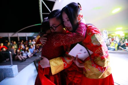 epa06037462 (18/34) Mother of transgender Chen Zhichao (L) hugs her daughter (C) and her partner Yang Jieli (R) during a LGBT (lesbian, gay, bisexual and transgender) mass wedding organised by the Parents and Friends of Lesbians and Gays (PFLAG) China organisation on a cruise in open seas on route to Sasebo, Japan, 15 June 2017. About 800 members of the Chinese LGBT (lesbian, gay, bisexual and transgender) community and their parents spent four days on a cruise trip organised by Parents and Friends of Lesbians and Gays (PFLAG) China, a grassroots non-government organisation, celebrating the 10th anniversary of the organisation. It aims to promote coexistence among homosexuals and their families. EPA/HOW HWEE YOUNG CHINA OUT ATTENTION: For the full PHOTO ESSAY text please see Advisory Notice epa06037443
