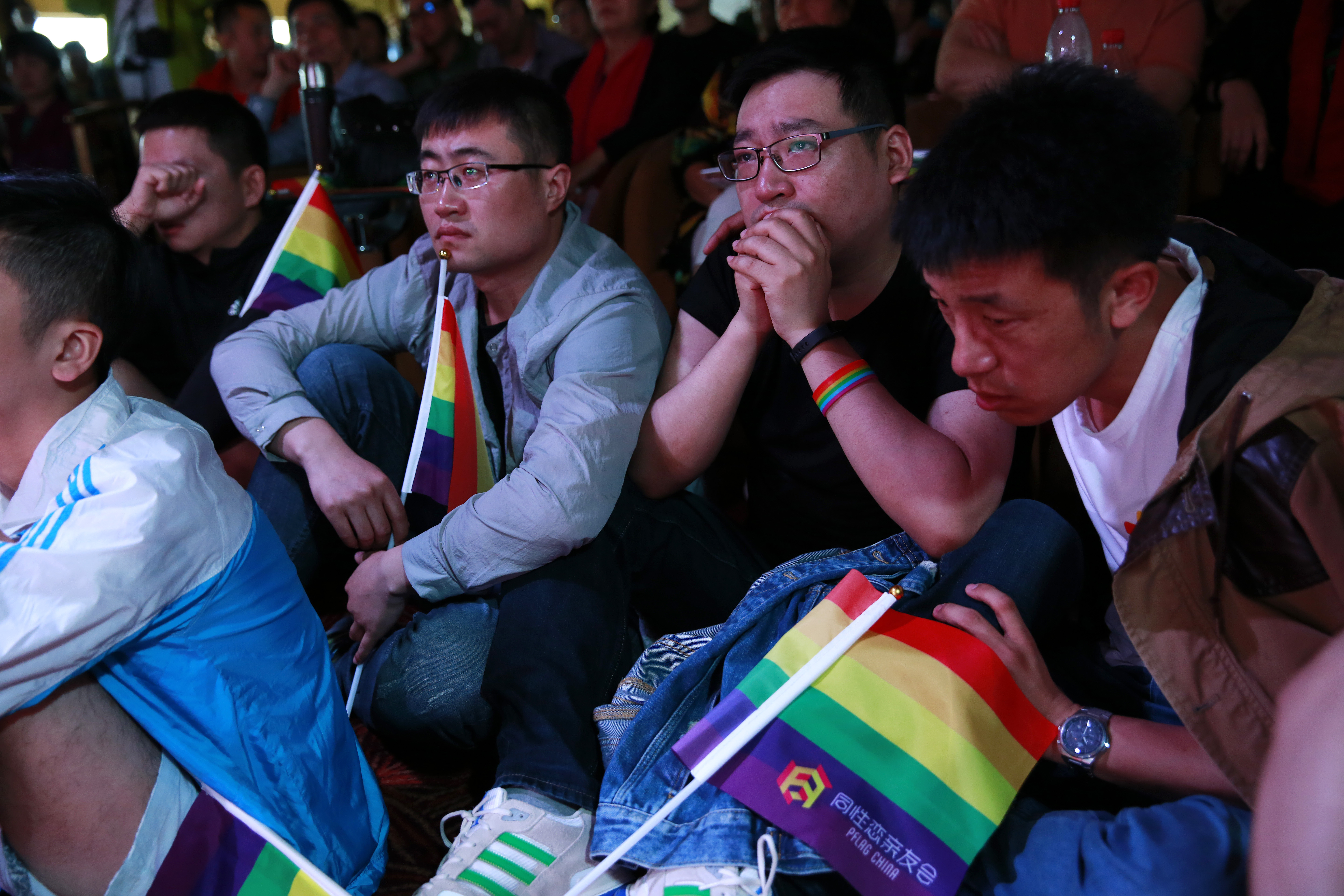 epa06037466 (22/34) Chinese gay men Da Zhi (R), Tank (2-R) and Xiao Rui reacts while listening to experiences shared by a lesbian Ding Limei and her mother comforts during a forum for LGBTs (lesbian, gay, bisexual and transgender) and their parents organised by the Parents and Friends of Lesbians and Gays (PFLAG) China organisation on a cruise in open seas on route to Sasebo, Japan, 15 June 2017. About 800 members of the Chinese LGBT (lesbian, gay, bisexual and transgender) community and their parents spent four days on a cruise trip organised by Parents and Friends of Lesbians and Gays (PFLAG) China, a grassroots non-government organisation, celebrating the 10th anniversary of the organisation. It aims to promote coexistence among homosexuals and their families. EPA/HOW HWEE YOUNG CHINA OUT ATTENTION: For the full PHOTO ESSAY text please see Advisory Notice epa06037443