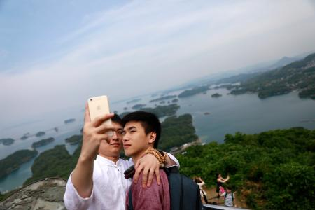 epa06037467 (23/34) A gay couple takes a selfie at a Saikai National Park during a stopover of a cruise organised by the Parents and Friends of Lesbians and Gays (PFLAG) China organisation at Sasebo, Nagasaki, Japan, 16 June 2017. About 800 members of the Chinese LGBT (lesbian, gay, bisexual and transgender) community and their parents spent four days on a cruise trip organised by Parents and Friends of Lesbians and Gays (PFLAG) China, a grassroots non-government organisation, celebrating the 10th anniversary of the organisation. It aims to promote coexistence among homosexuals and their families. EPA/HOW HWEE YOUNG CHINA OUT ATTENTION: For the full PHOTO ESSAY text please see Advisory Notice epa06037443