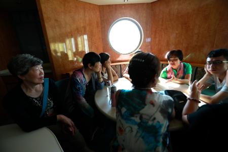 epa06037471 (26/34) 80 year-old Wang Fuying, who has a lesbian granddaughter, listens to other parents sharing their experiences on a cruise organised by the Parents and Friends of Lesbians and Gays (PFLAG) China organisation in open seas on route back to Shanghai China, 17 June 2017. Wang has accepted her granddaughter and see that it is something she could not change.About 800 members of the Chinese LGBT (lesbian, gay, bisexual and transgender) community and their parents spent four days on a cruise trip organised by Parents and Friends of Lesbians and Gays (PFLAG) China, a grassroots non-government organisation, celebrating the 10th anniversary of the organisation. It aims to promote coexistence among homosexuals and their families. EPA/HOW HWEE YOUNG CHINA OUT ATTENTION: For the full PHOTO ESSAY text please see Advisory Notice epa06037443