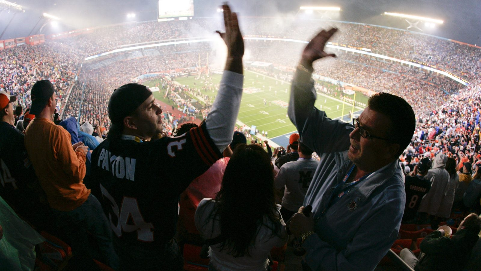 Chicago Bears fans high-five as they celebrate a touchdown during the first quarter of the Super Bowl XLI football game against the Indianapolis Colts at Dolphin Stadium in Miami, Sunday, Feb. 4, 2007. (AP Photo/Julie Jacobson)