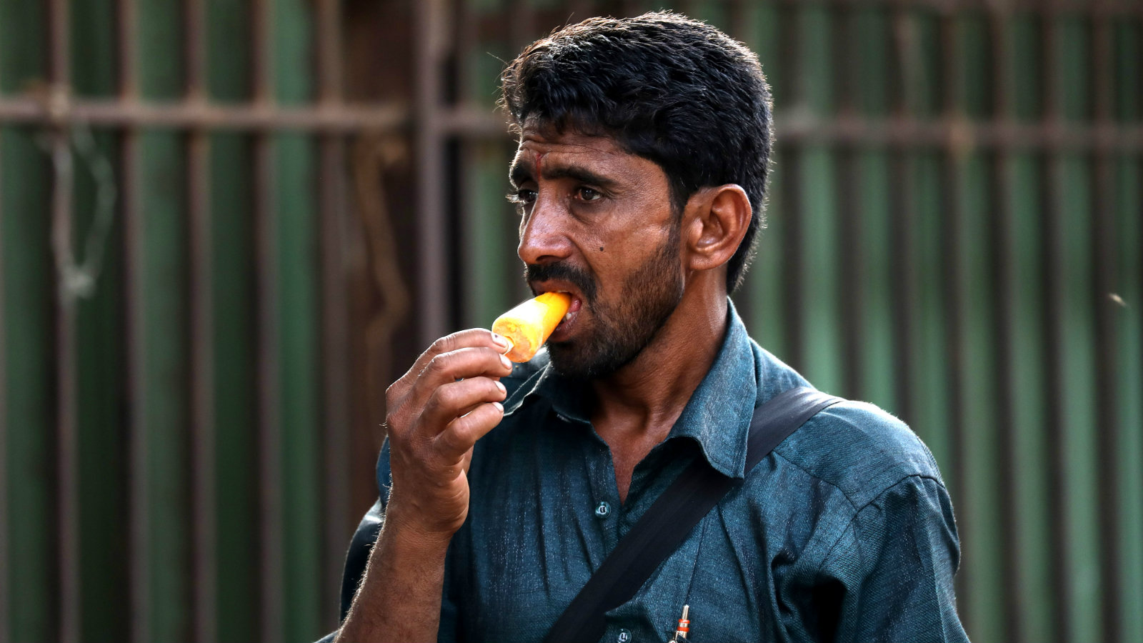 An Indian man eats ice-cream to cool himself during a hot sunny day in Mumbai, India, 30 March 2017. According to reports, large parts of Maharashtra are under heat wave, with unusual temperature hovering above 40 degree Celsius.