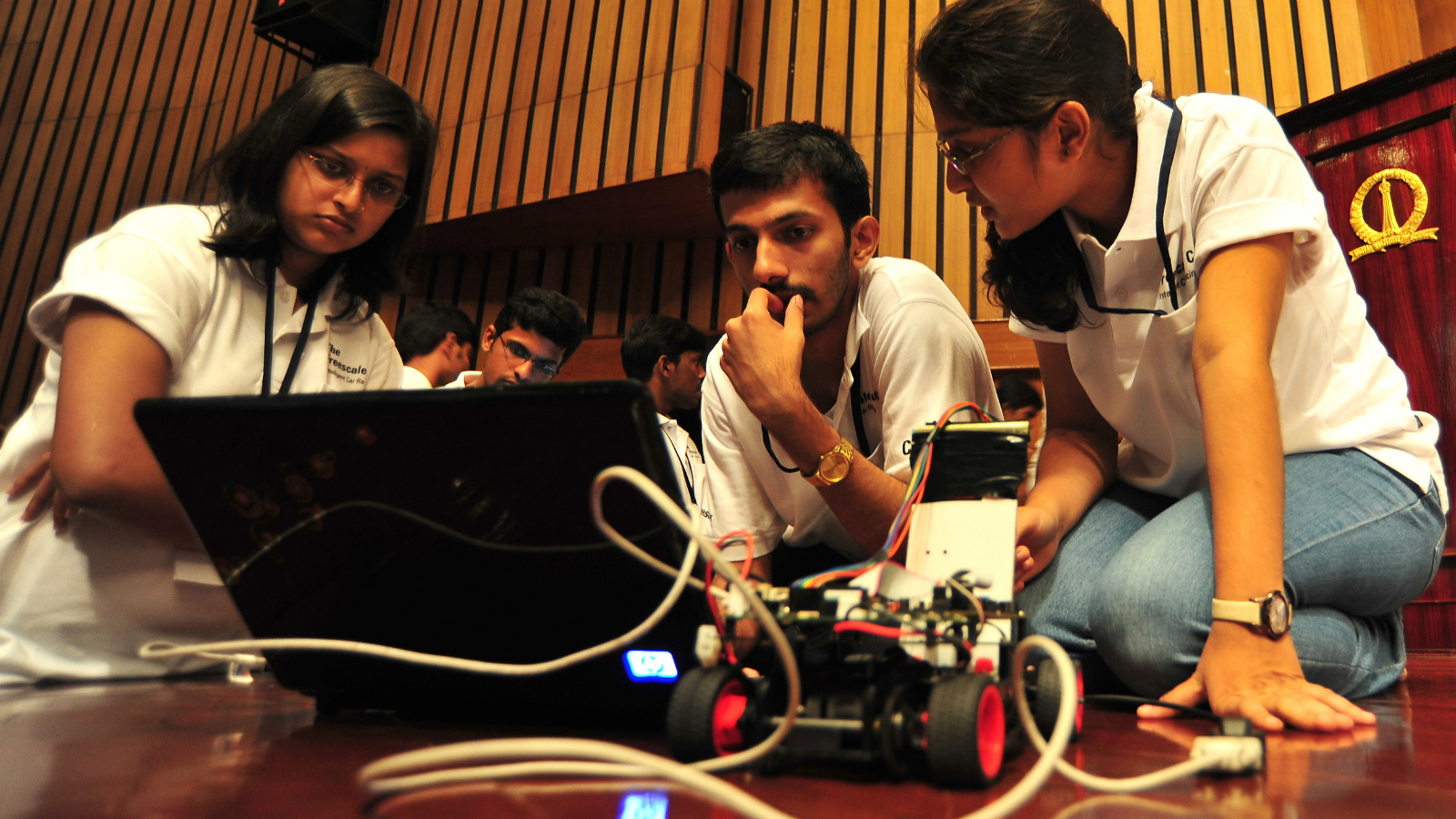 Engineering students from various colleges prepare their smart cars before taking part in the 'unique intelligent car race' for engineering students organized by Freescale Semiconductor India in association with Centre for Electronic Design and Technology (CEDT) from the Indian Institute of Science, in the southern Indian city of Bangalore, on 19 September 2011. Around 127 teams from 35 engineering college students across India, take part in the Freescale's global imitative to promote innovation among engineering students and offer them a hands on opportunity to their engineering skills to test by creating microcontroller (MCU) programming that enables model cars to perform optimally under test conditions during the race.