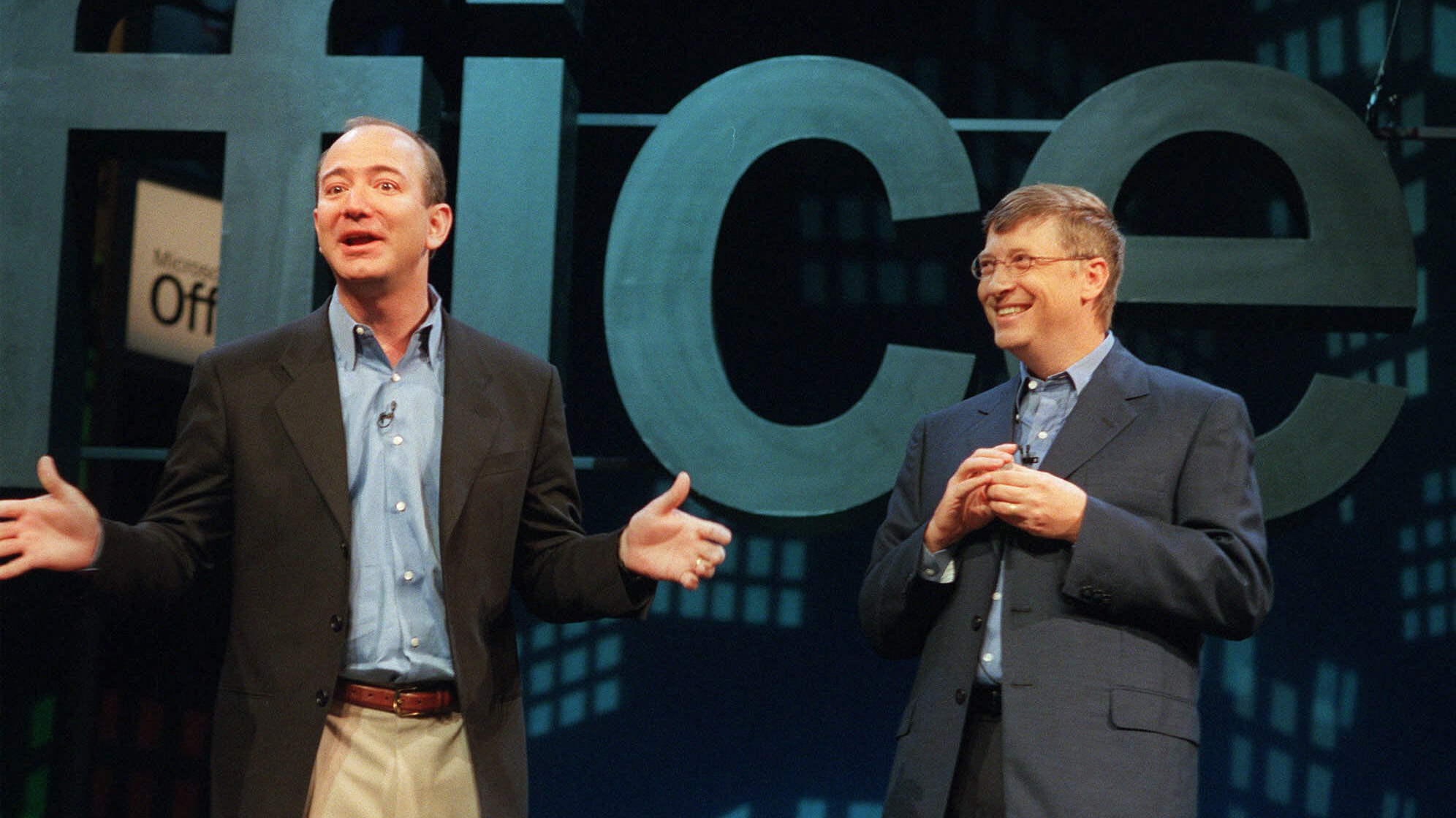 Jeff Bezos, founder and CEO of Amazon.com, left, meets with Bill Gates, Microsoft Corp. chairman and chief software architect, at a New York news conference to launch Microsoft's new software, Office XP, Thursday, May 31, 2001. Gates said Office XP will improve worker productivity, but he acknowledged that there was room for improvement to the product. (AP Photo/Marty Lederhandler)