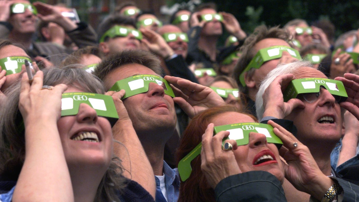 Solar eclipse viewers protect their eyes as they watch the moon shade the sun in Hamburg on Wednesday, August 11, 1999. This is the final total solar eclipse of the millennium.