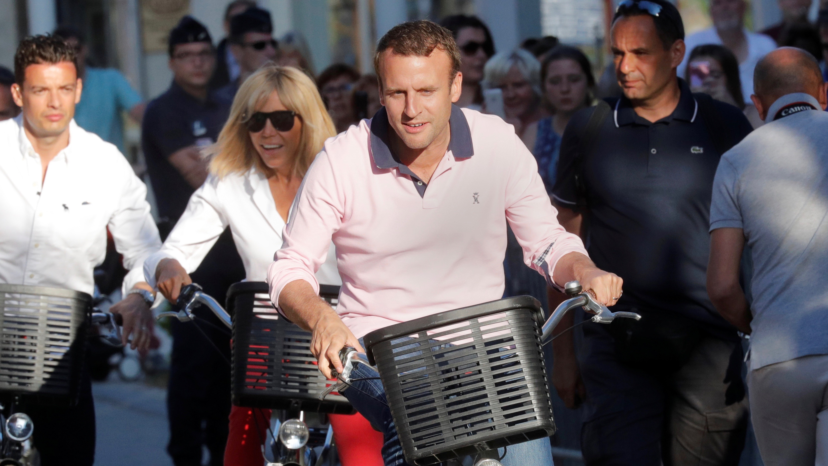 Macron and his wife on bicycles.