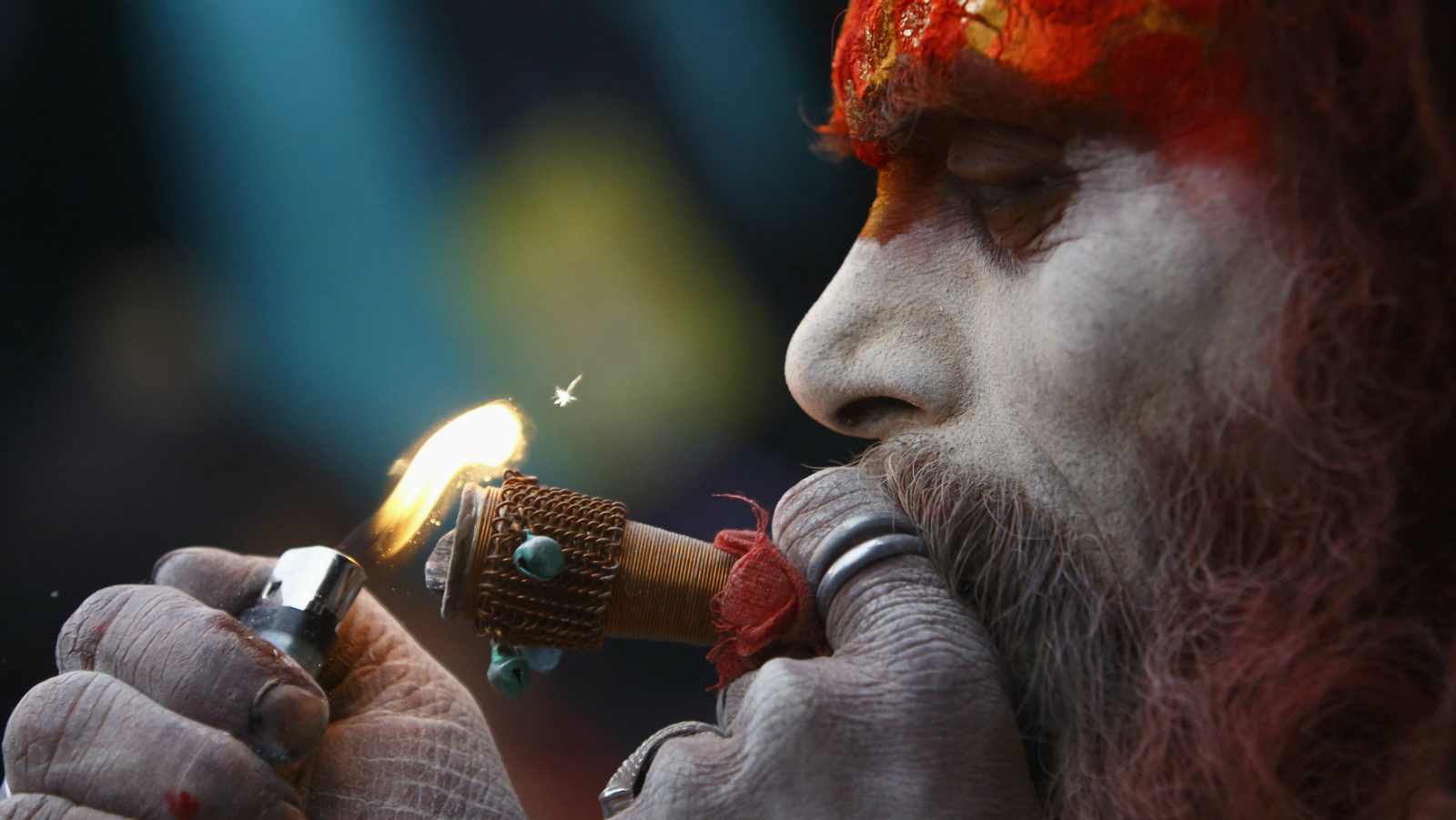A Hindu holy man, or sadhu, smokes marijuana on a chillum (pipe) at the premises of Pashupatinath Temple during the Shivaratri festival in Kathmandu February 27, 2014. Hindu holy men from Nepal and India come to this temple to take part in the Shivaratri festival. Celebrated by Hindu devotees all over the world, Shivaratri is dedicated to Lord Shiva, and holy men mark the occasion by praying, smoking marijuana or smearing their bodies with ashes.