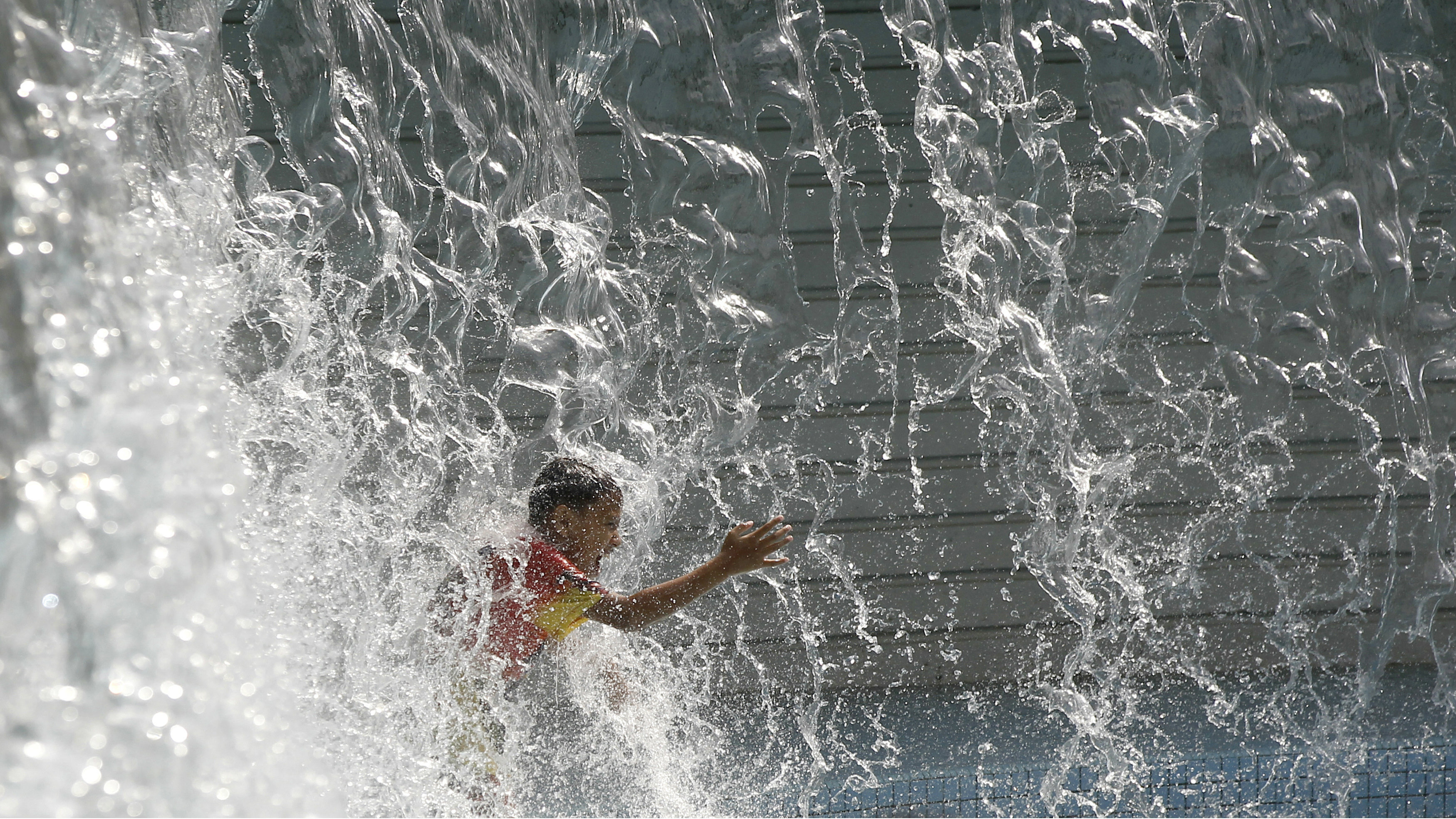 A boy plays at KLCC water park in Kuala Lumpur, Malaysia Wednesday, July 5, 2017.
