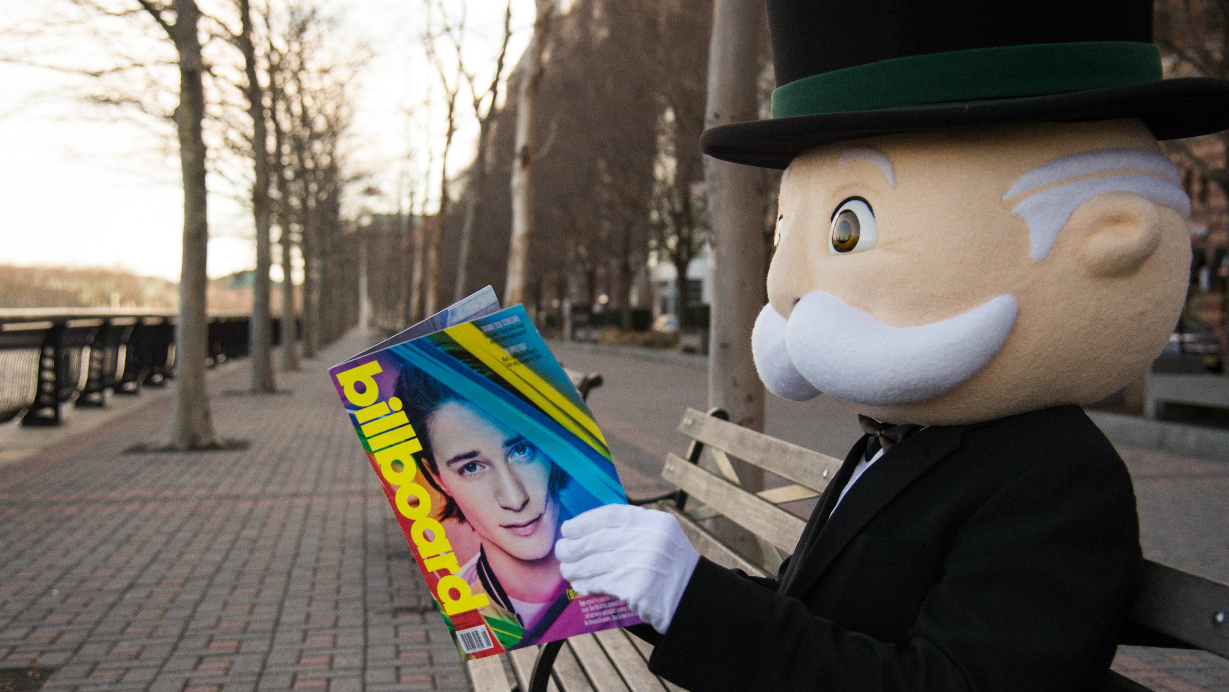 Monopoly man reading Billboard magazine