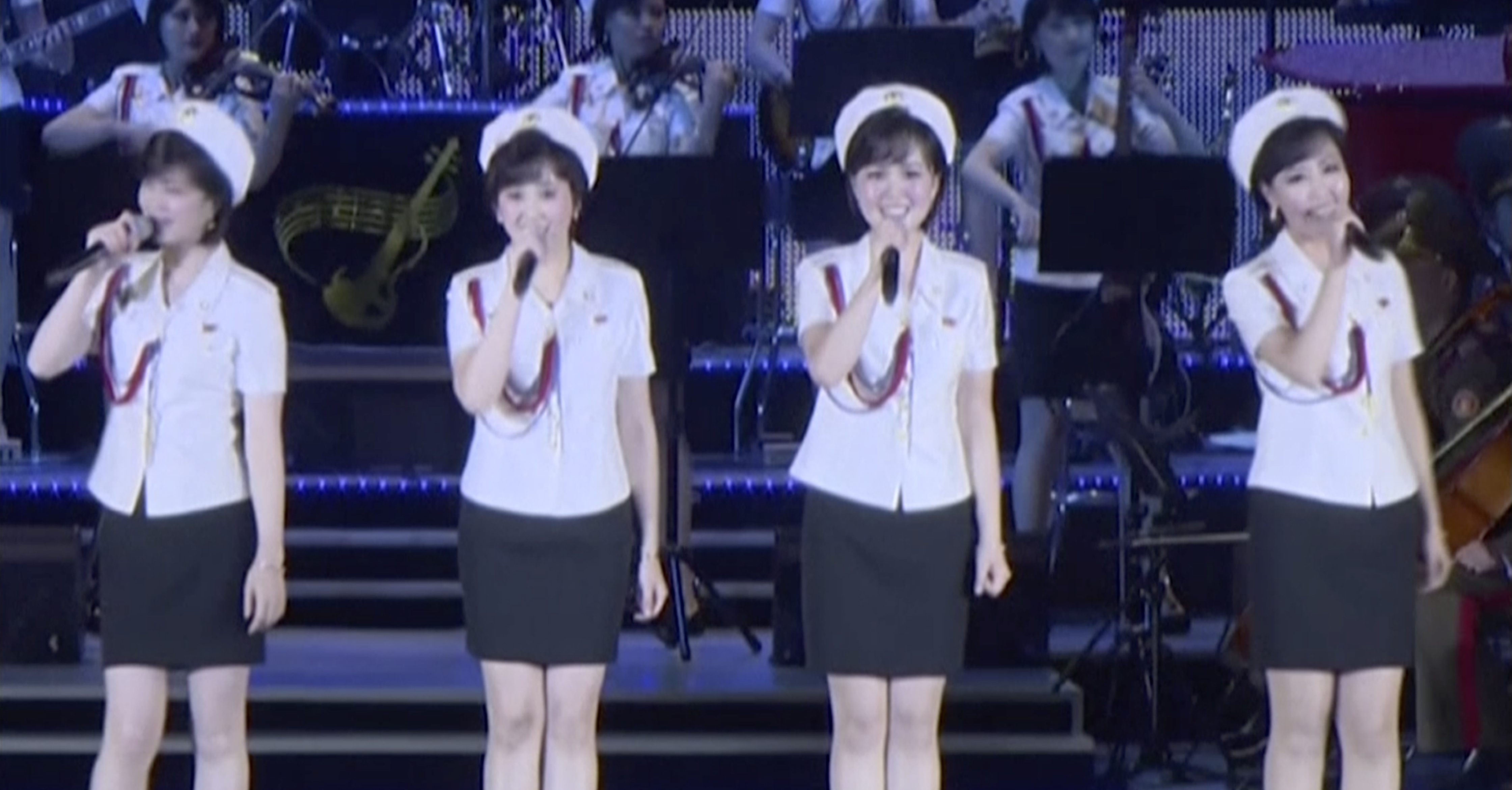 This image made from undated video of a news bulletin aired by North Korea's KRT on July 10, 2017, North Korea's Moranbong Band, an all-female ensemble that was hand-picked by leader Kim Jong Un, performs in Pyongyang. Kim attended a concert replete with pop music and thunderous applause to fete the successful launch of his country's first intercontinental ballistic missile.