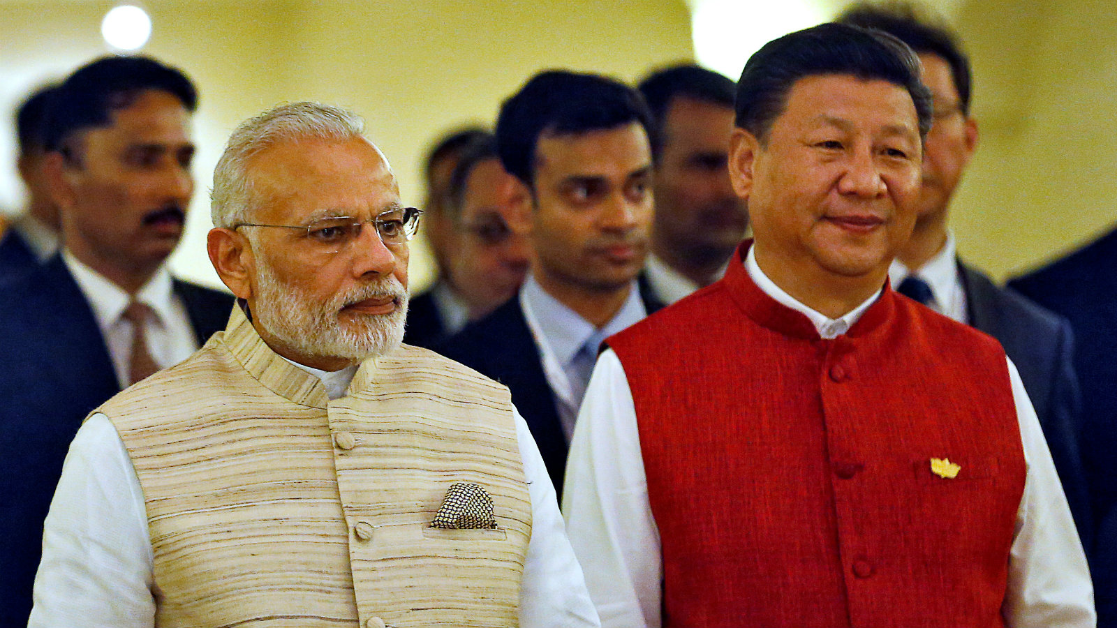 Indian Prime Minister Narendra Modi (L) and Chinese President Xi Jinping arrive for a photo opportunity ahead of BRICS (Brazil, Russia, India, China and South Africa) Summit in Benaulim, in the western state of Goa, India, October 15, 2016.