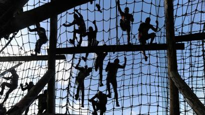 competitors climbing ropes