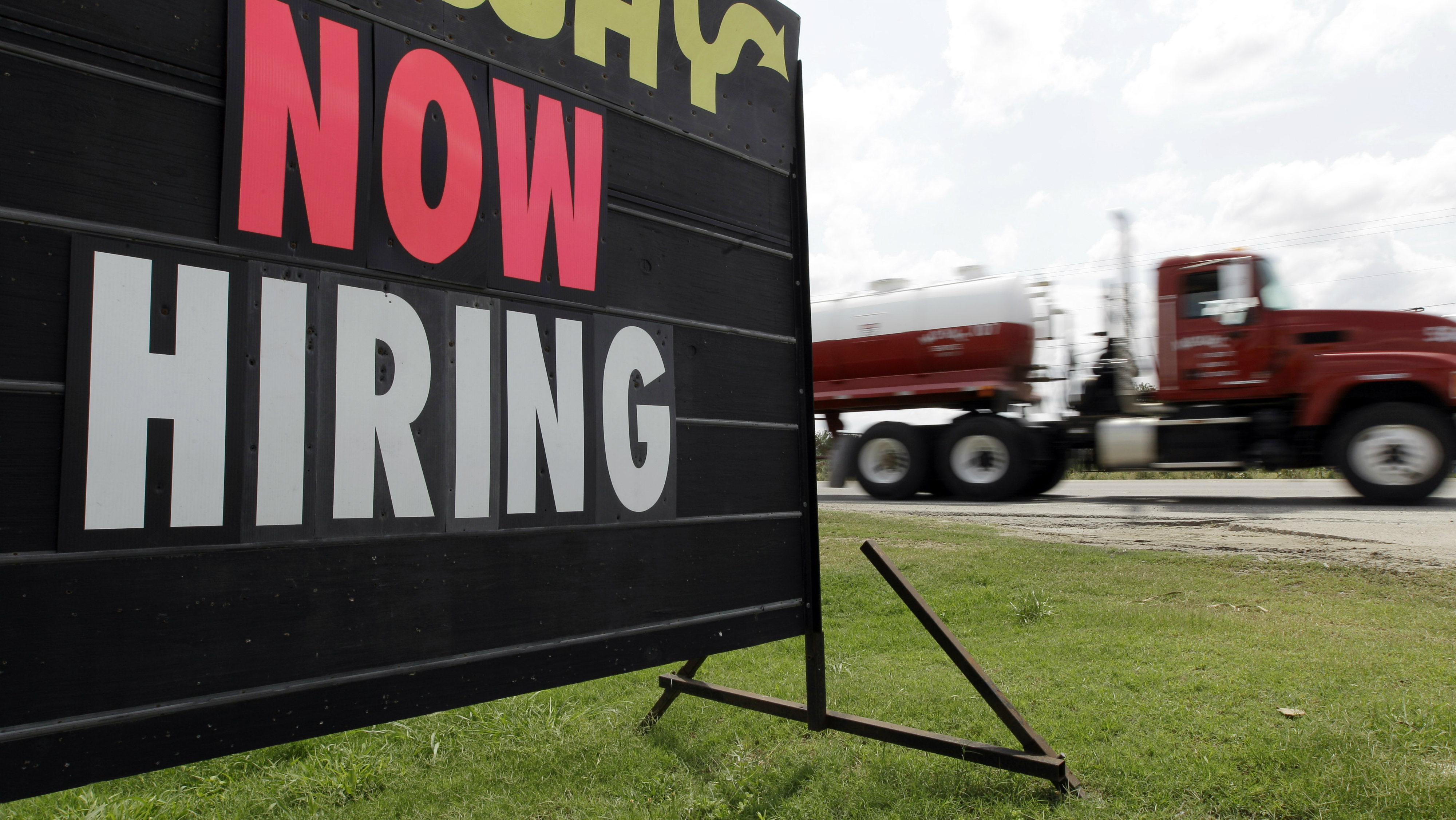 """A """"Now Hiring"""" sign"""