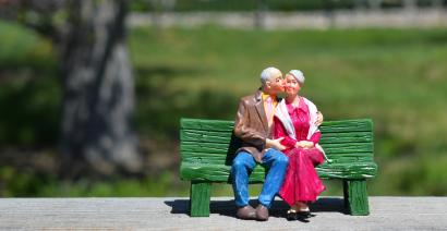 Old couple figurines sat on bench