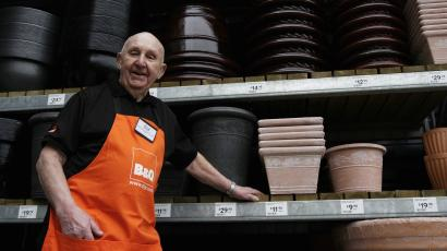 Older worker at B&Q poses for picture