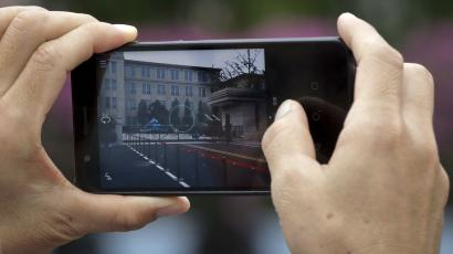 Someone taking a photo with a smartphone.