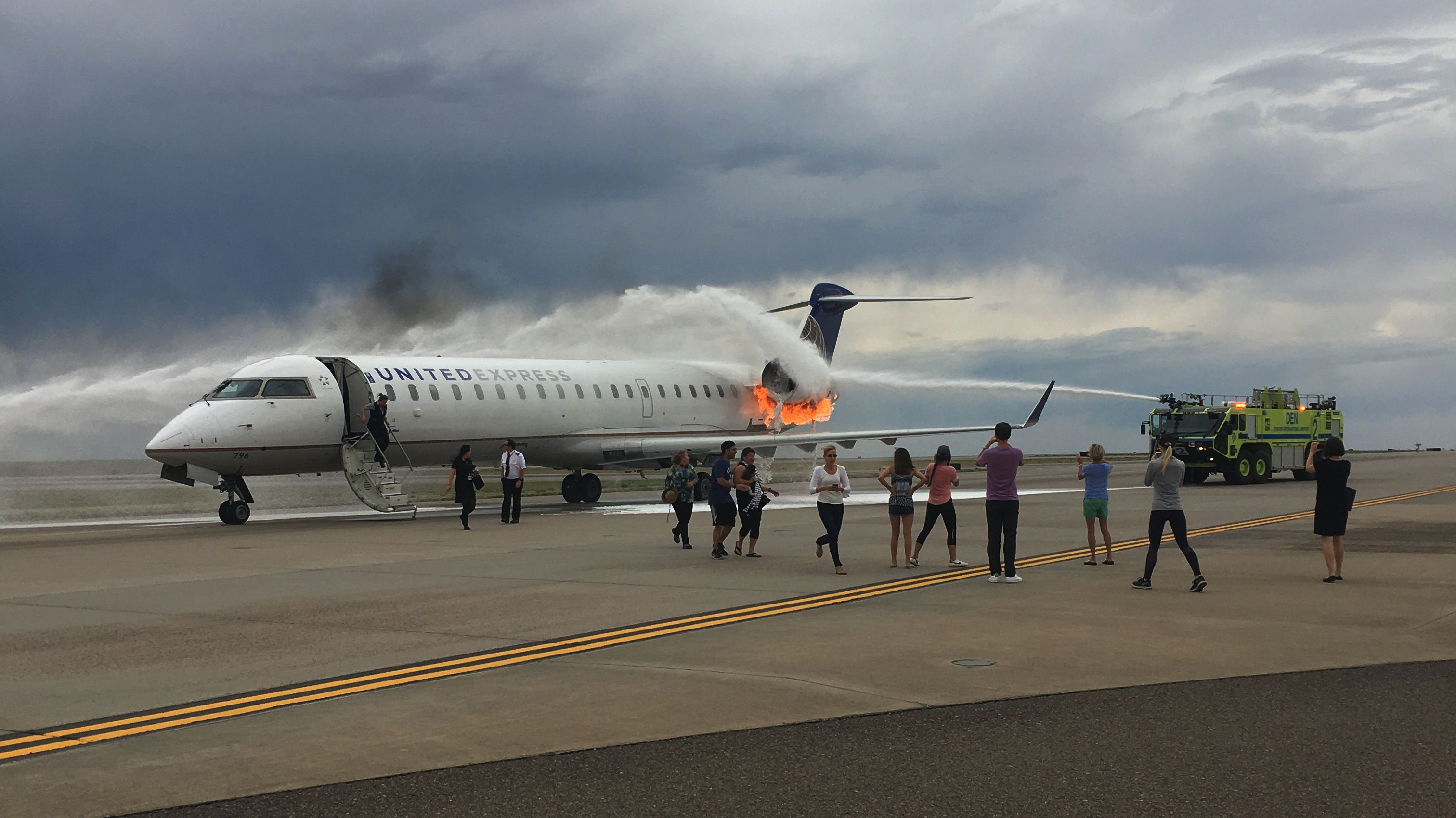 United Express Denver plane on tarmac on fire