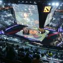 Fans watch a competition during The International Dota 2 Championships at Key Arena in Seattle, Washington
