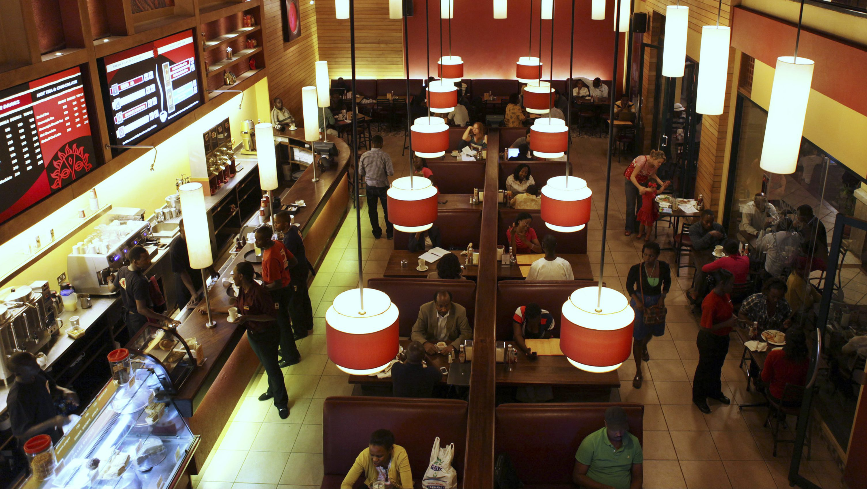 An interior view of a Nairobi Java House outlet in Nairobi January 20, 2012. Kenya's rich and new middle classes have a growing taste for coffee and ice cream. That's just one sign that African states such as Kenya are changing. Even as rich countries face slowdown, sub-Saharan African economies are expected to post nearly 6 percent average growth in 2012, according to the IMF. A study by the International Finance Corporation, part of the World Bank, has pointed to the potential of the continent's more than 1 billion people, millions of whom have moved out of subsistence agriculture and into urban jobs over the past decade. Picture taken January 20, 2012.   To match Insight AFRICA/SPENDERS-INFLATION