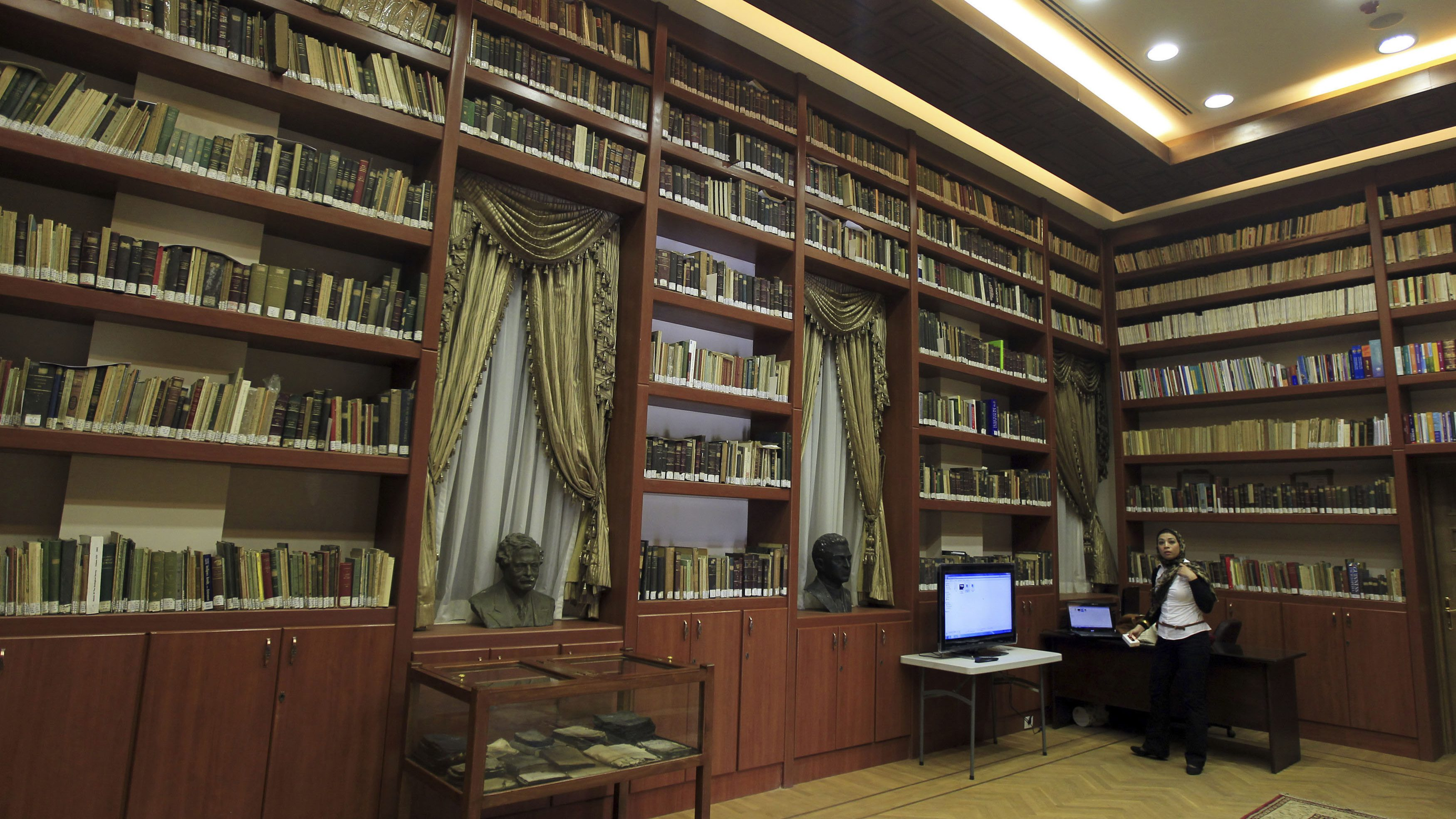 A woman visits the Scientific Institute after it reopened after restoration works, in Cairo