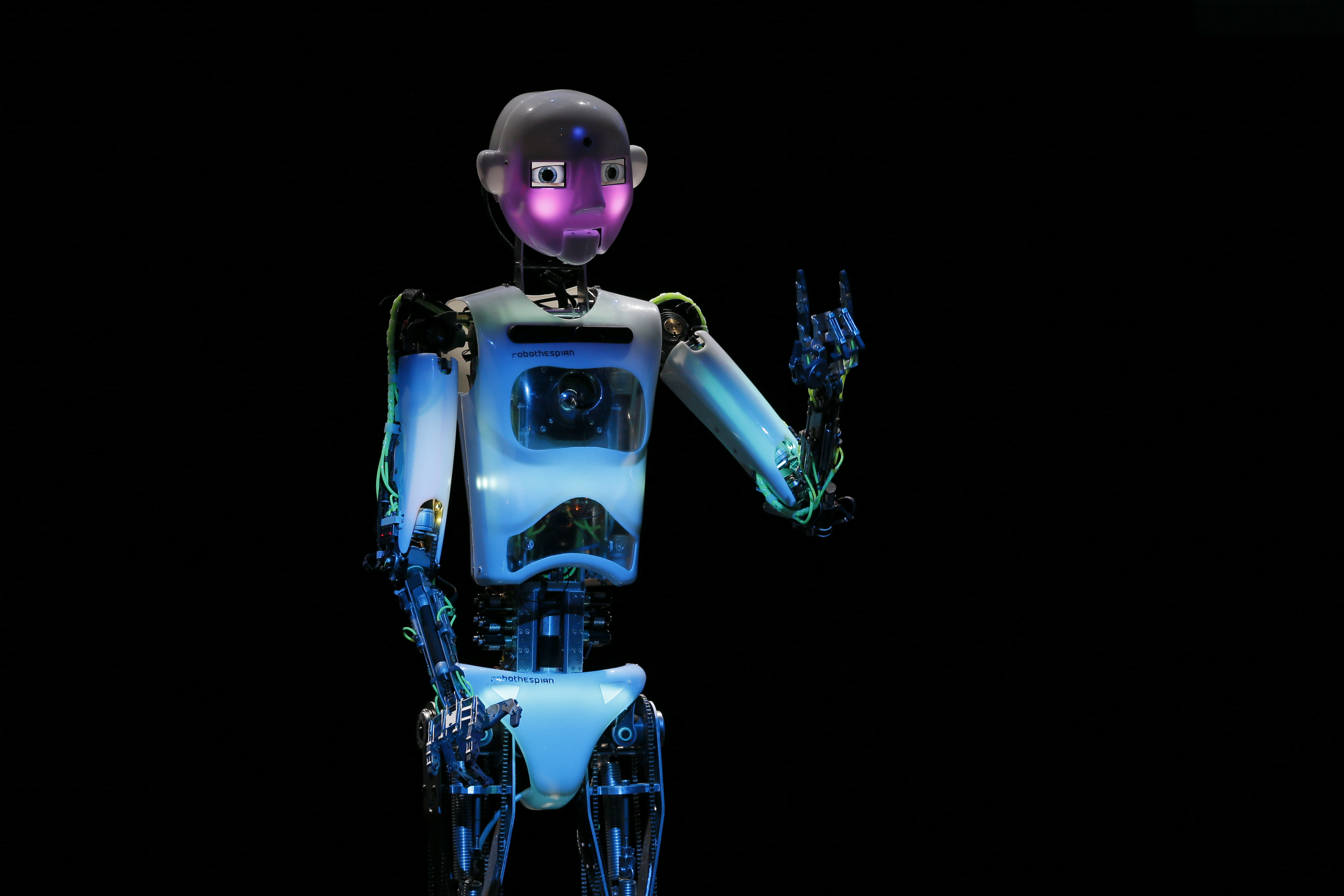 Humanoid robot of British company RoboThespian blushes during the opening ceremony of the Hanover technology fair Cebit