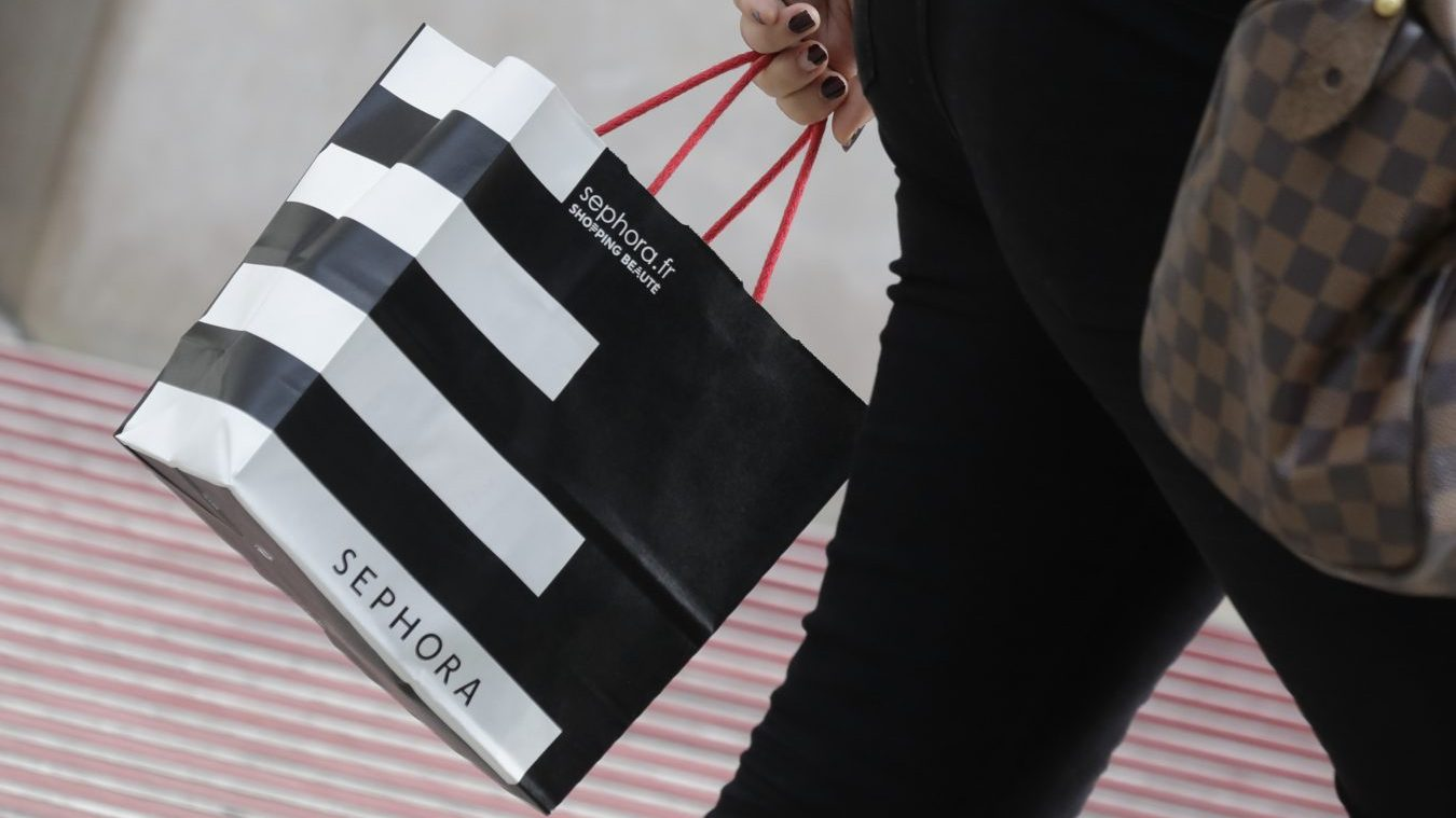 A woman walks with a Sephora shopping bag as she leaves a Sephora store in Paris July 23, 2014. Sephora, the top seller of Dior lip gloss and Lancome face creams, is under attack in continental Europe from far less glamorous competitors: pharmacies. New data shows specialist beauty retailers such as Sephora, one of the fastest growing companies at world No. 1 luxury group LVMH, are losing market share to pharmacies offering cheaper products.