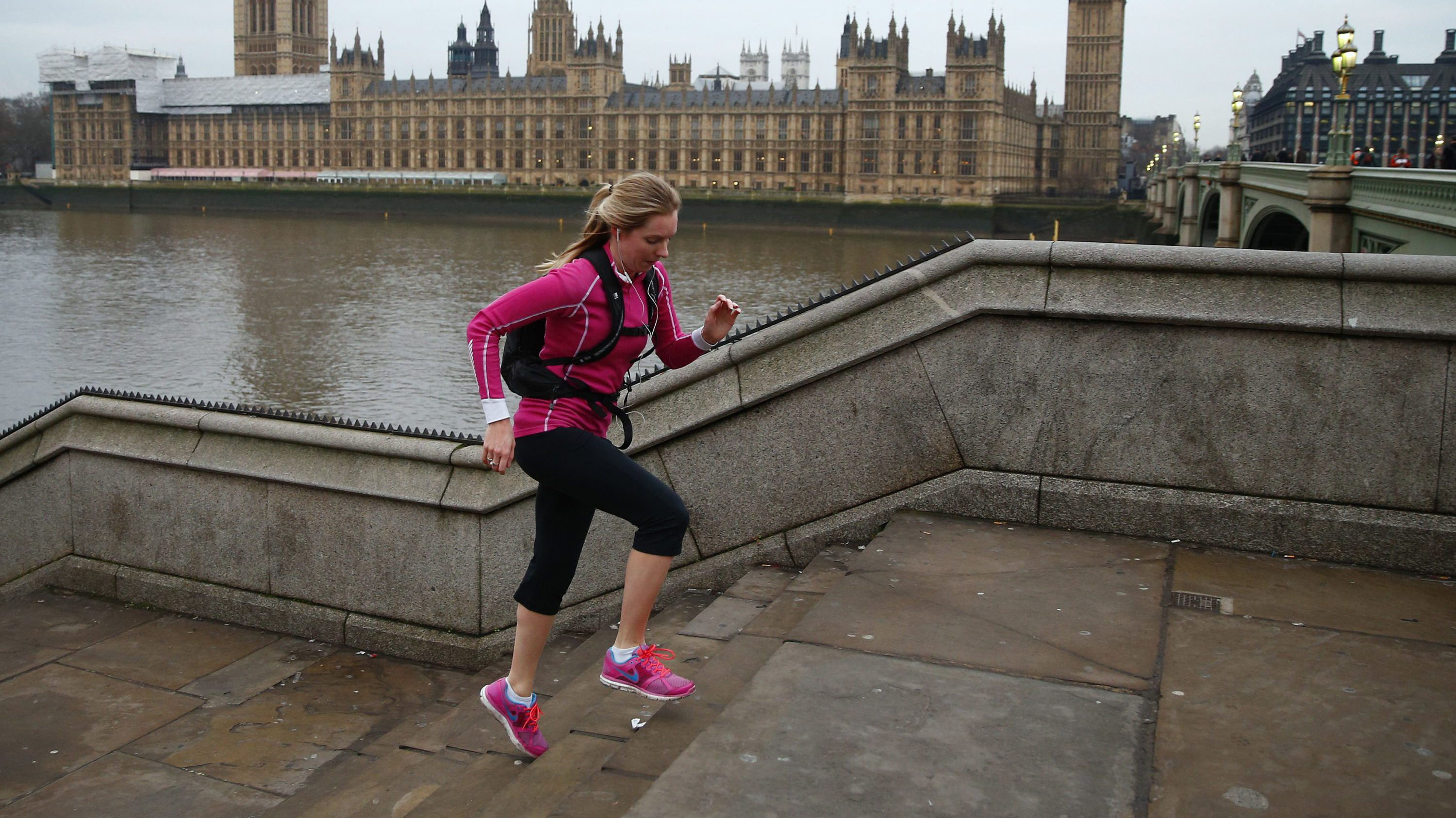 A jogger takes an early morning run in central London January 5, 2015.