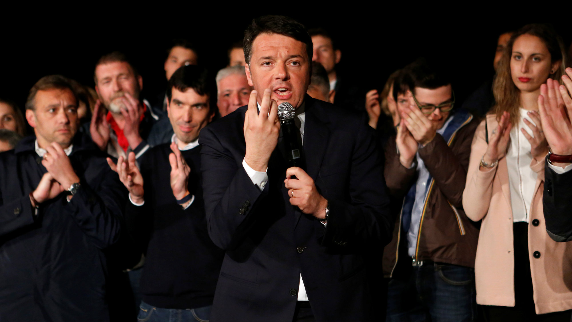 Italy's former Prime Minister Matteo Renzi speaks to a crowd