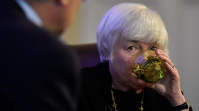 The Federal Reserve Board Chairwoman Janet Yellen sips water as she speaks during a discussion