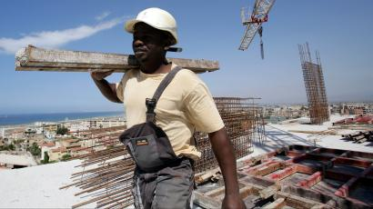 Kamara, 29, a migrant from Guinea, works at the construction site of a building in Algiers, Algeria June 29, 2017. Picture taken June 29, 2017.
