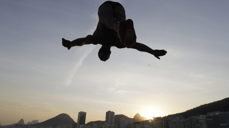 2016 Rio Olympics - Leme Beach - Rio de Janeiro, Brazil - 06/08/2016. A bather dives into the ocean.