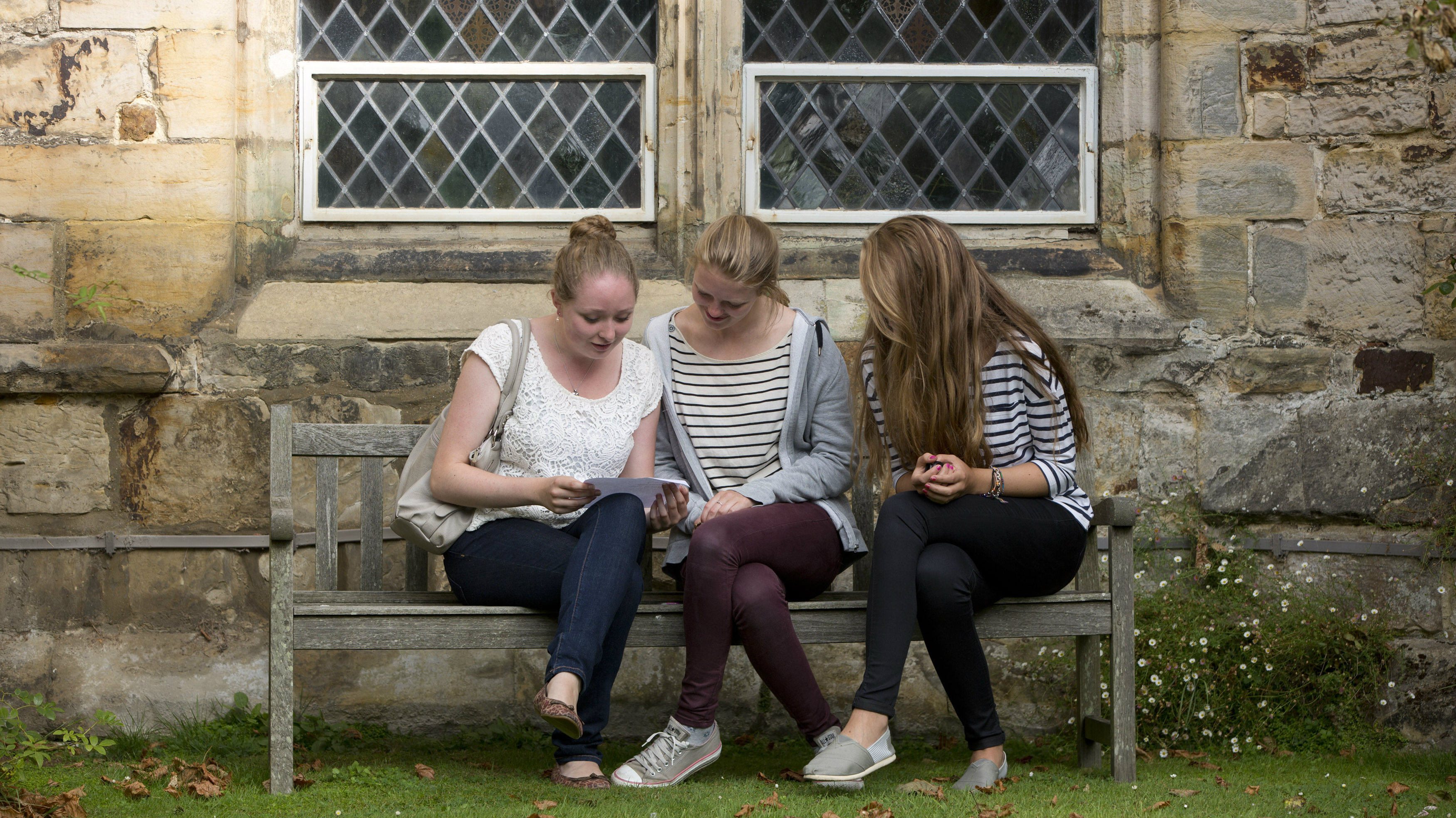 Pupils react after receiving their A-level exam results at St Leonards-Mayfield School in Mayfield, southern...