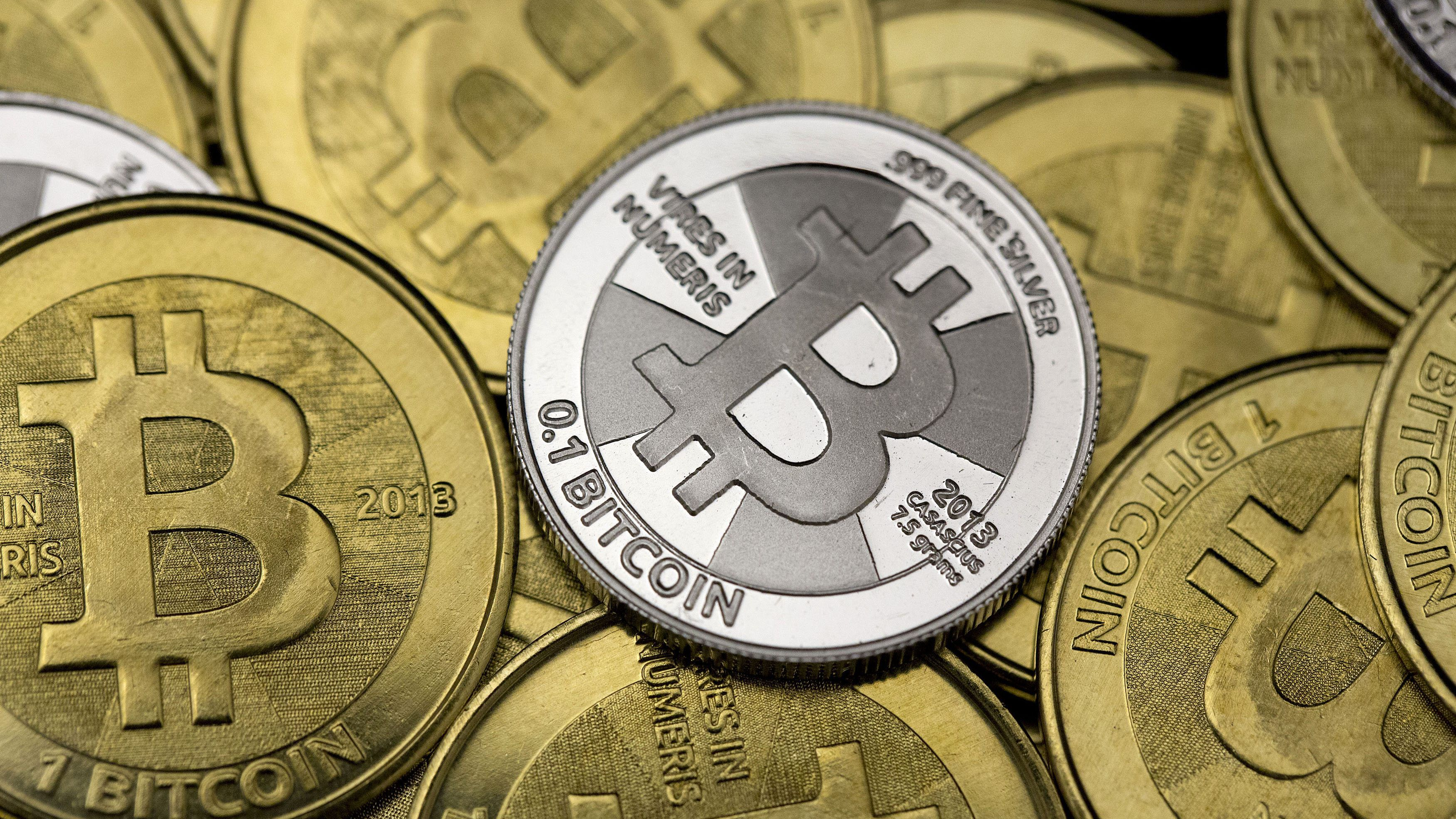 Some of Bitcoin enthusiast Mike Caldwell's coins are pictured at his office in this photo illustration in Sandy, Utah, January 31, 2014.