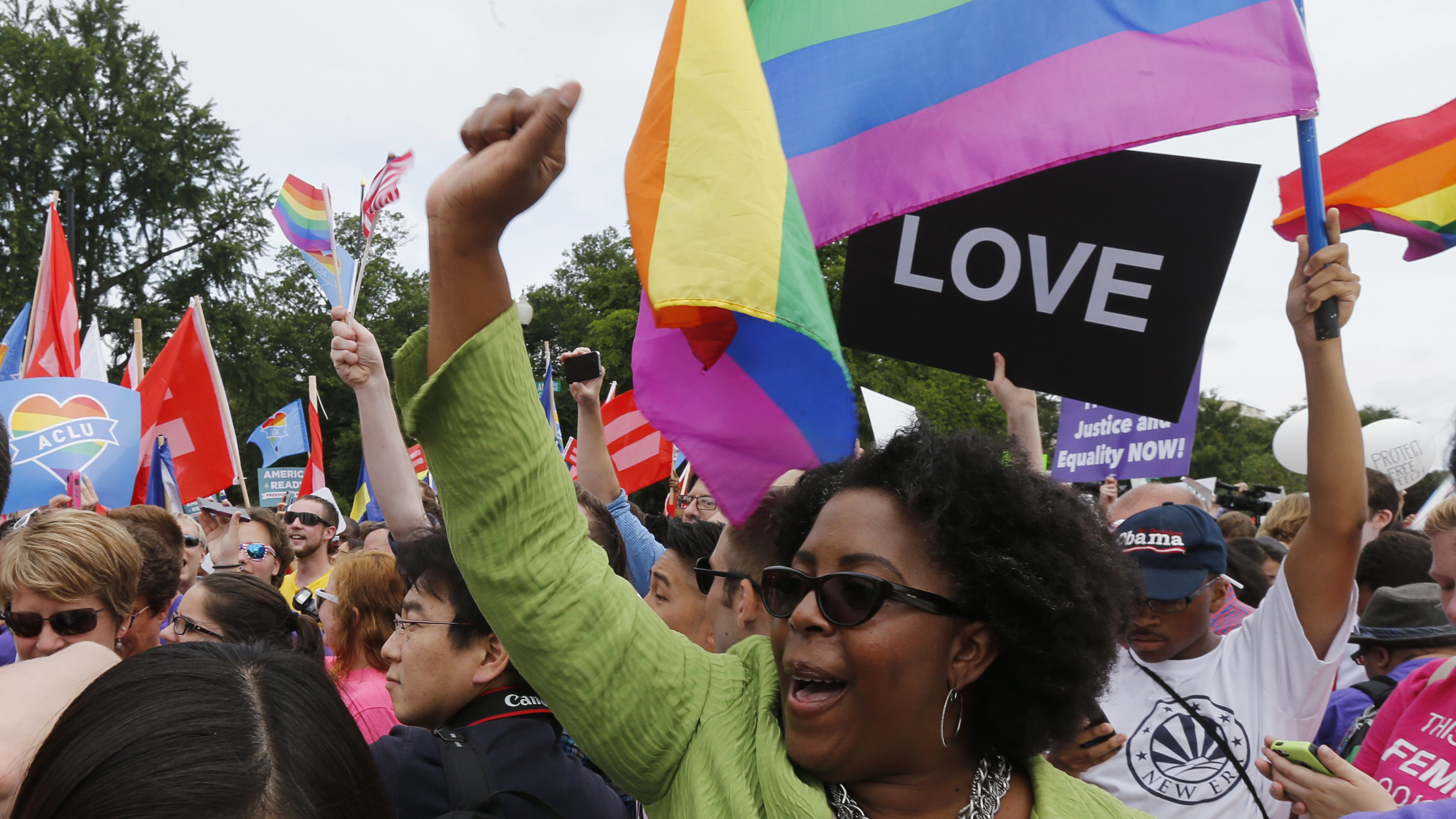 Gay rights supporters celebrate outside the U.S. Supreme Court building