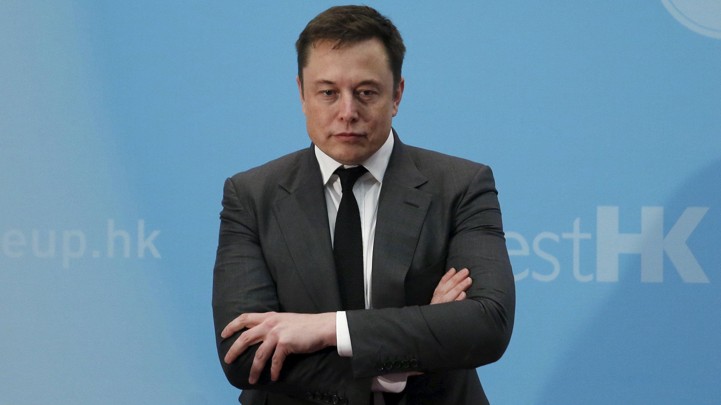 Elon Musk folding his arms