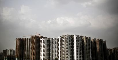 A view shows a residential complex that is under construction in Noida