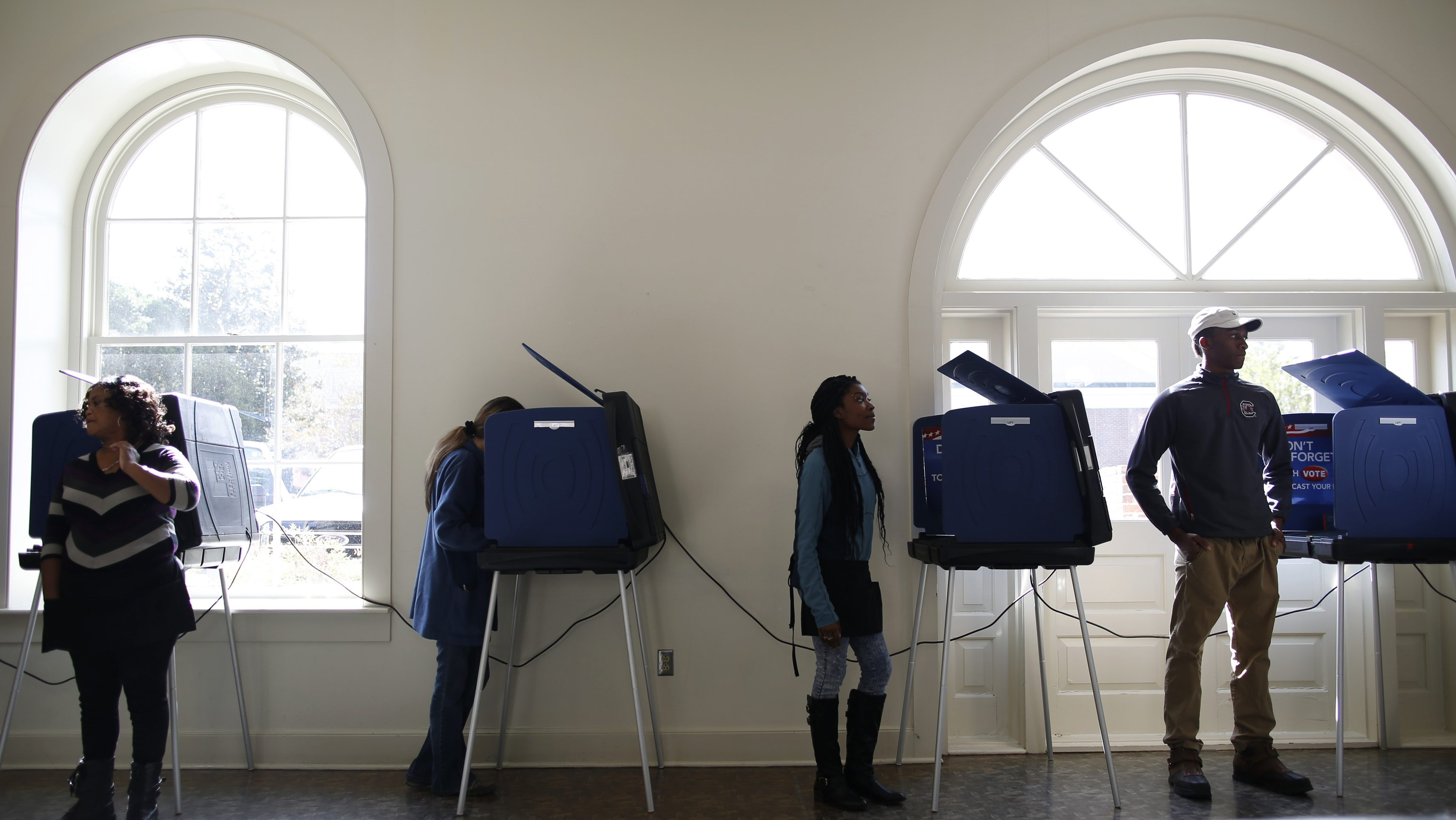 Poll workers and voters stand by the voting machines at the Marion 2 precinct at the Marion Opera House during the U.S. presidential election in Marion, South Carolina, U.S. November 8, 2016. REUTERS/Randall Hill - RTX2SKQK