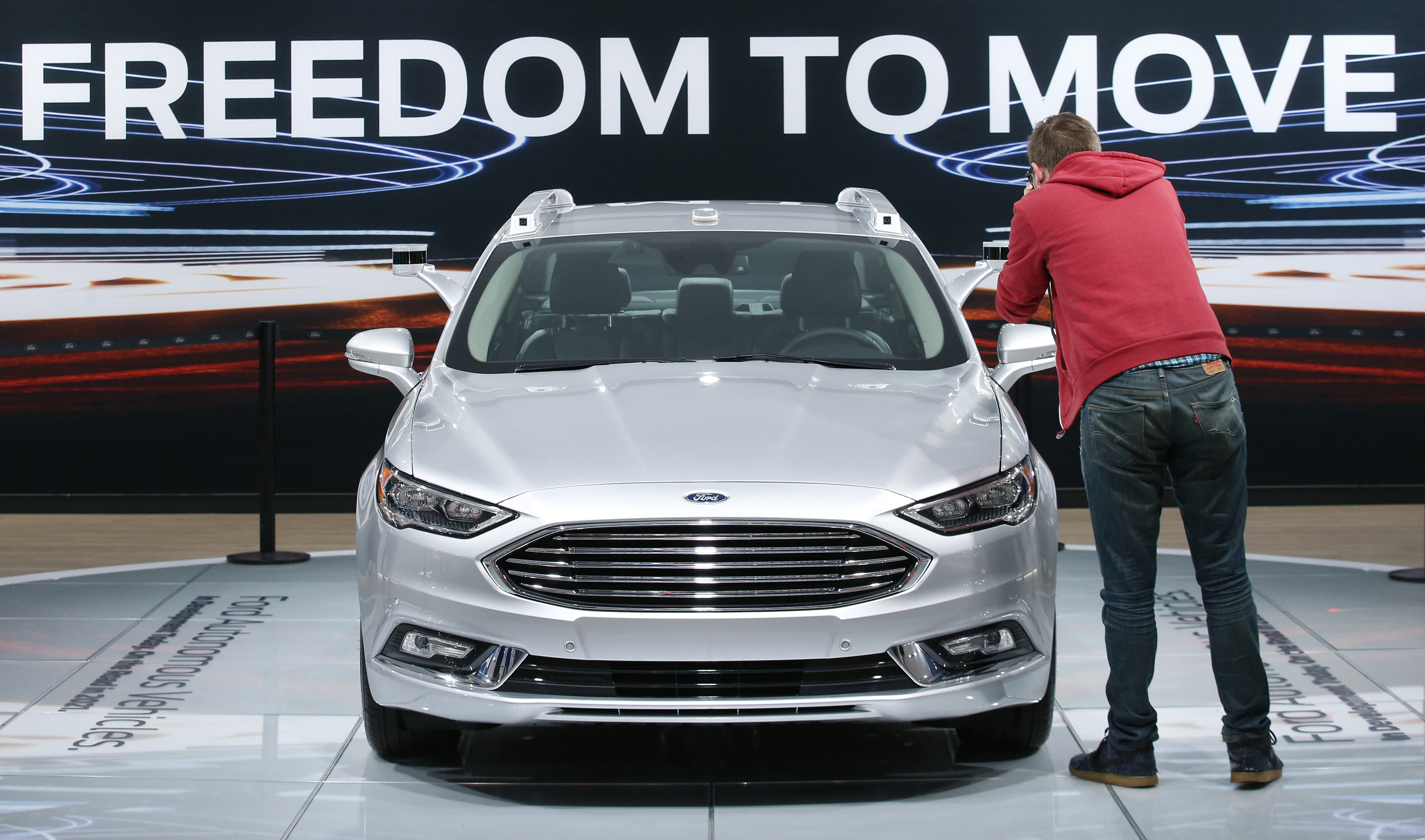 A Ford Fusion Titanium Hybrid autonomous car is displayed during the North American International Auto Show in Detroit
