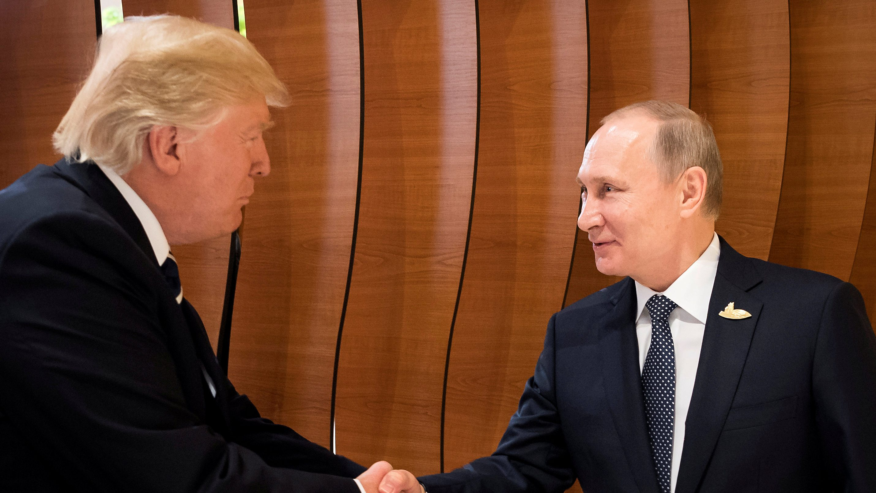 U.S. President Donald Trump and Russia's President Vladimir Putin shake hands during the G20 Summit in Hamburg, Germany in this still image taken from video, July 7, 2017. REUTERS/Steffen Kugler/Courtesy of Bundesregierung/Handout via REUTERS ATTENTION EDITORS - THIS PICTURE WAS PROVIDED BY A THIRD PARTY. NO RESALES. NO ARCHIVE      TPX IMAGES OF THE DAY - RTX3AHCA