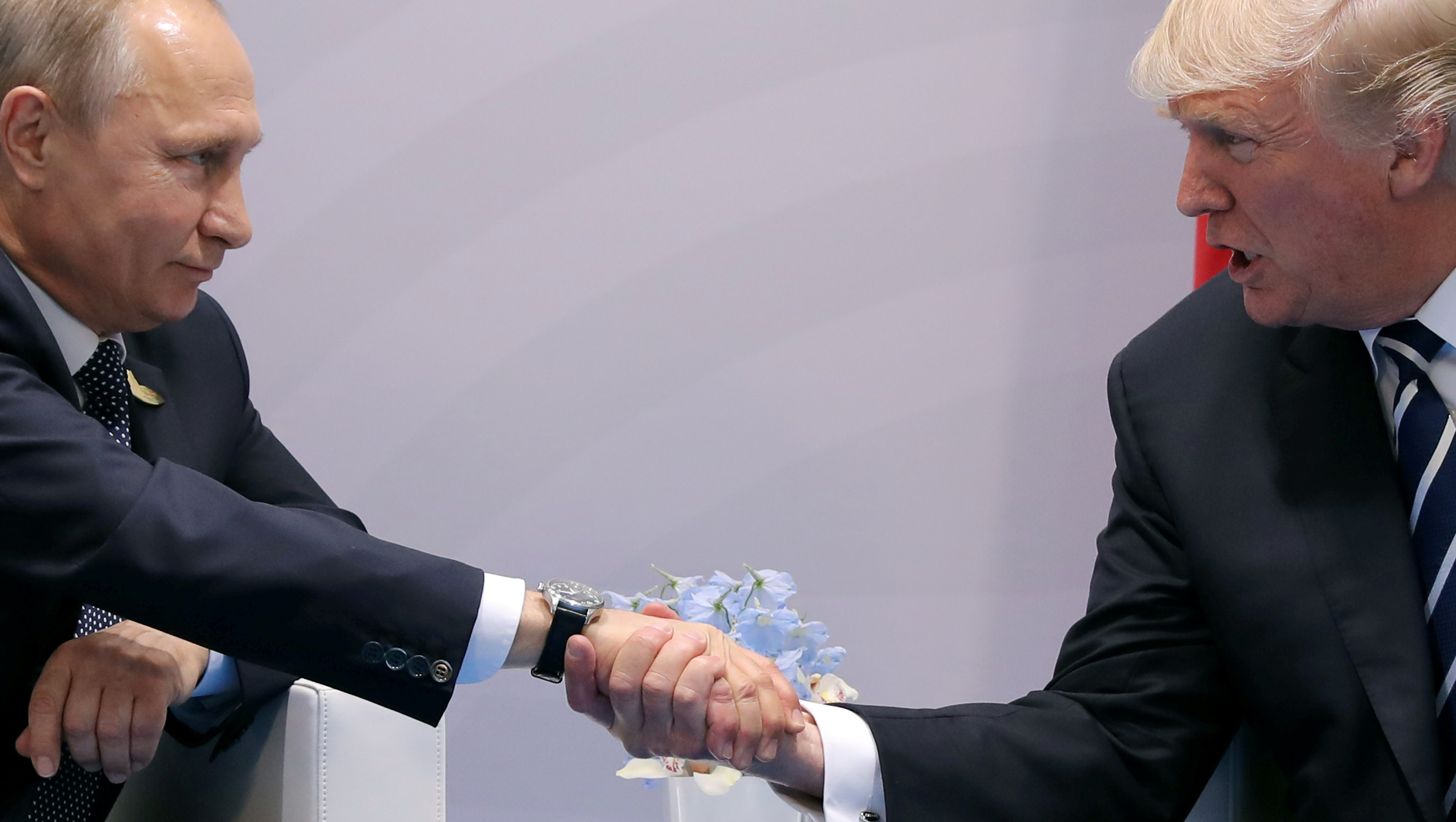U.S. President Donald Trump shakes hands with Russian President Vladimir Putin during the their bilateral meeting at the G20 summit in Hamburg, Germany July 7, 2017. REUTERS/Carlos Barria     TPX IMAGES OF THE DAY - RTX3AIAJ