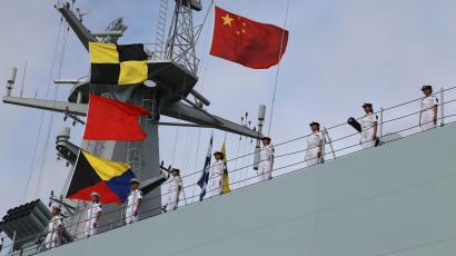 Soldiers of China's People's Liberation Army (PLA) stand on a ship sailing off from a military port in Zhanjiang, Guangdong province, July 11, 2017. Picture taken July 11, 2017.