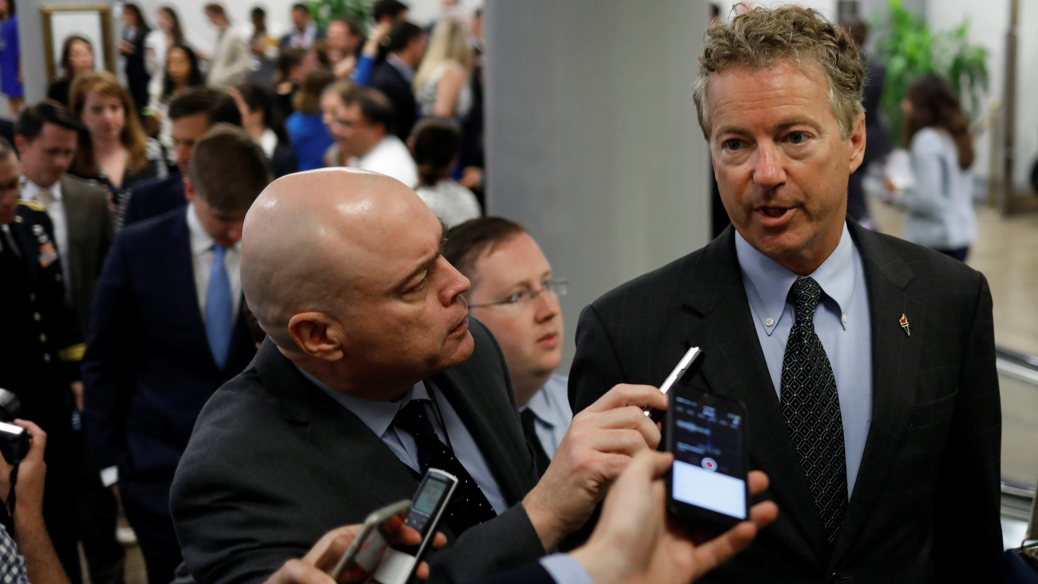 Senator Rand Paul (R-KY) speaks with reporters about the withdrawn Republican health care bill on Capitol Hill in Washington, U.S., July 18, 2017. REUTERS/Aaron P. Bernstein - RTX3BYNZ