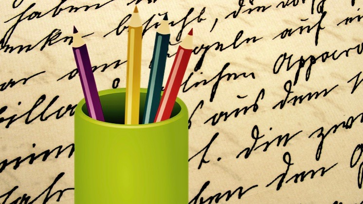Cursive document and pencils.